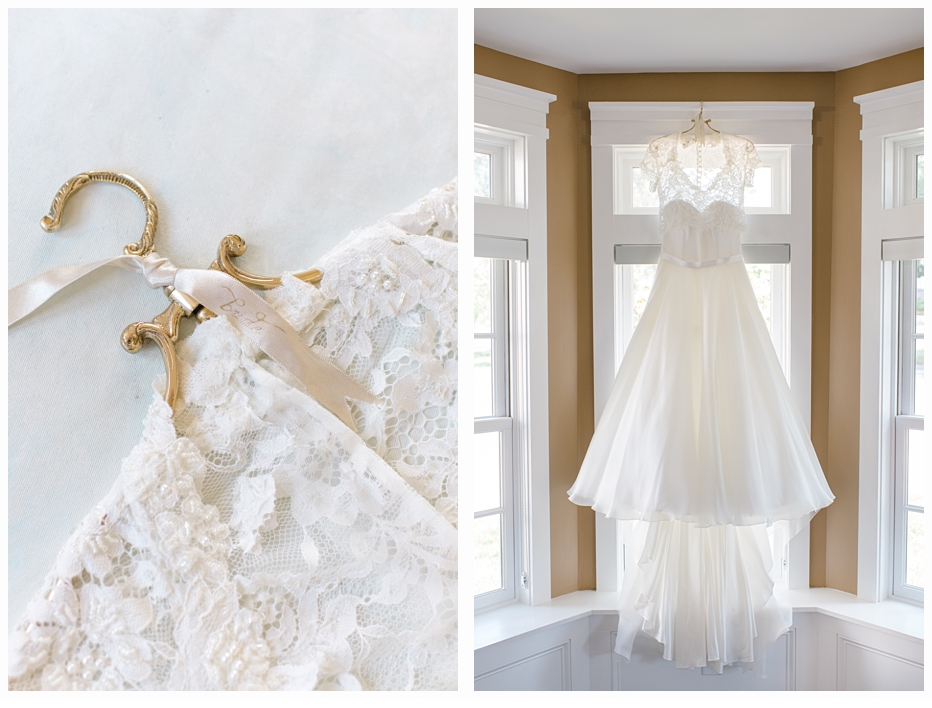wedding gown on a gold hanger hanging in window