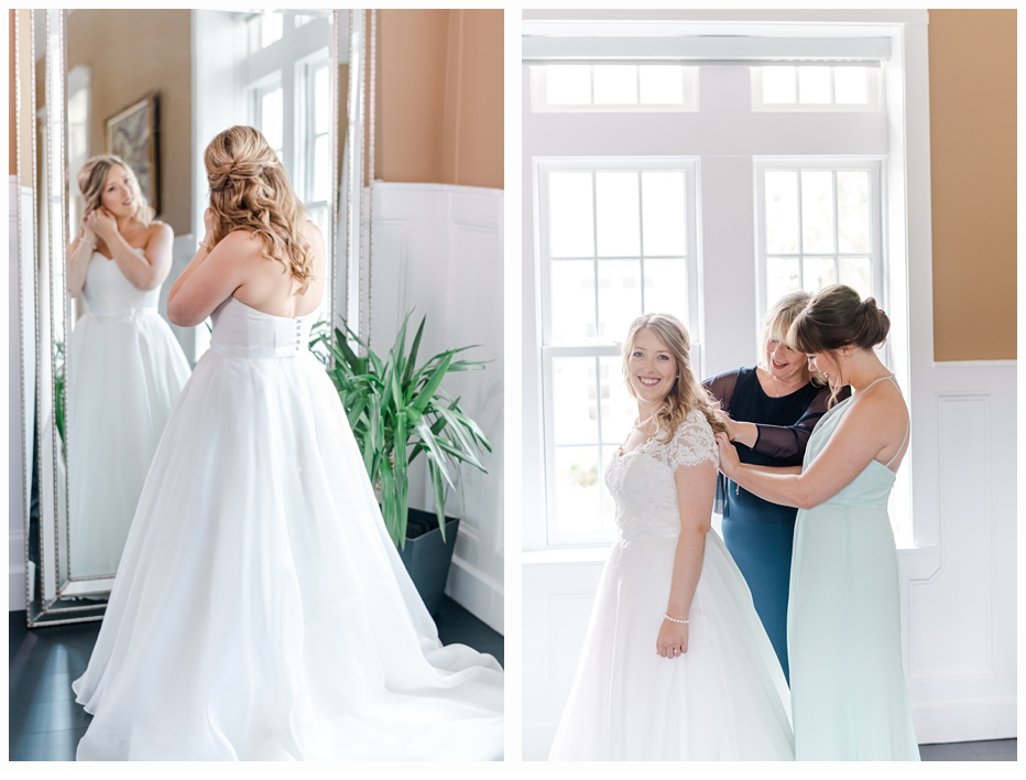 mom and maid of honor helping bride put on wedding gown