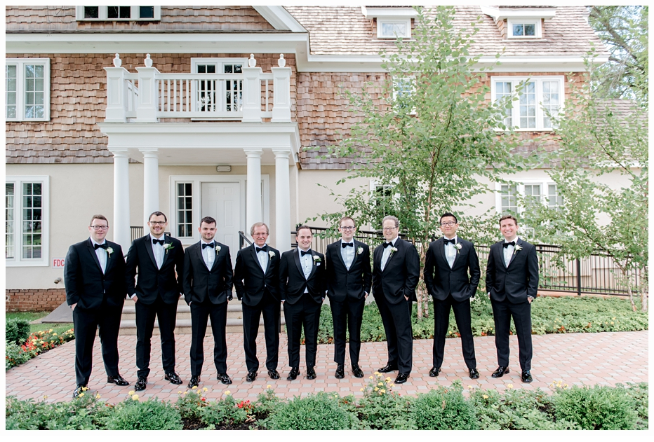 groom and groomsmen taking a photo