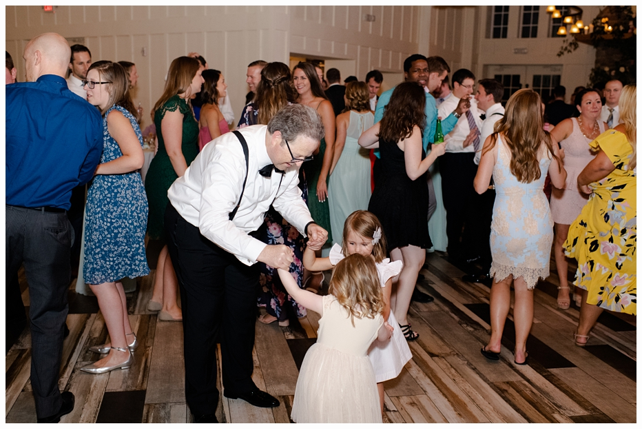 grandfather dancing with granddaughter at wedding
