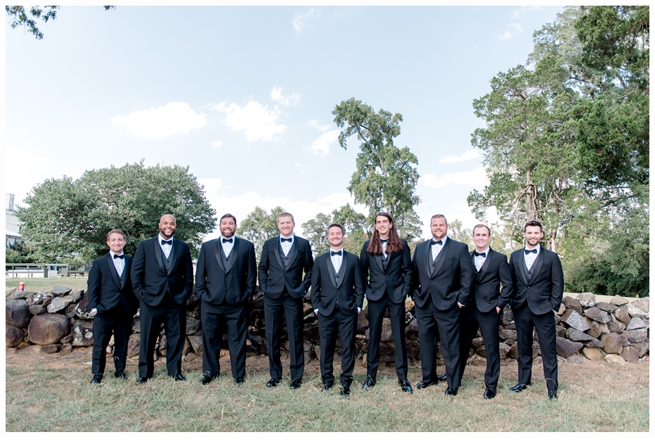 groom and groomsmen taking a portrait outside