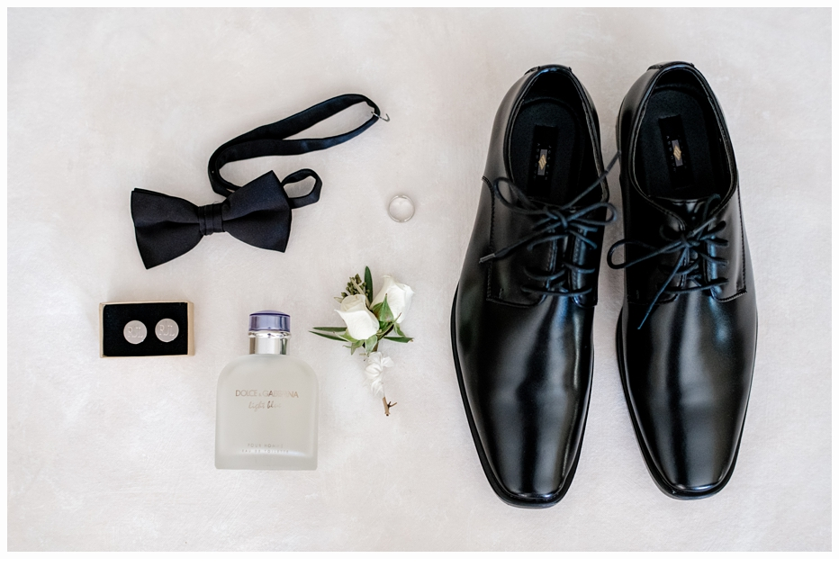 grooms tie, shoes and cufflings on a mat
