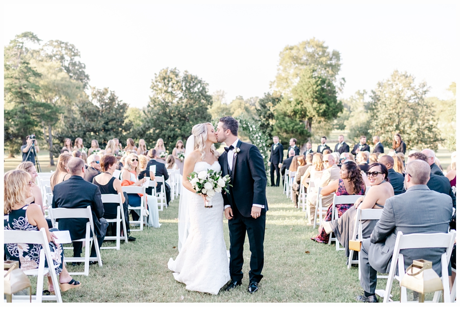 bride and groom kissing after they became man and wife