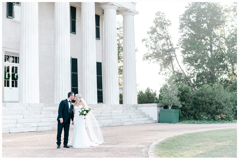 bride and groom kissing during their portraits
