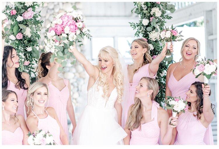 bride cheering with bridesmaids