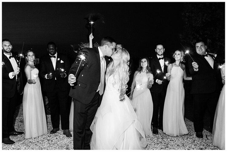 bridal party doing a sparkler exit