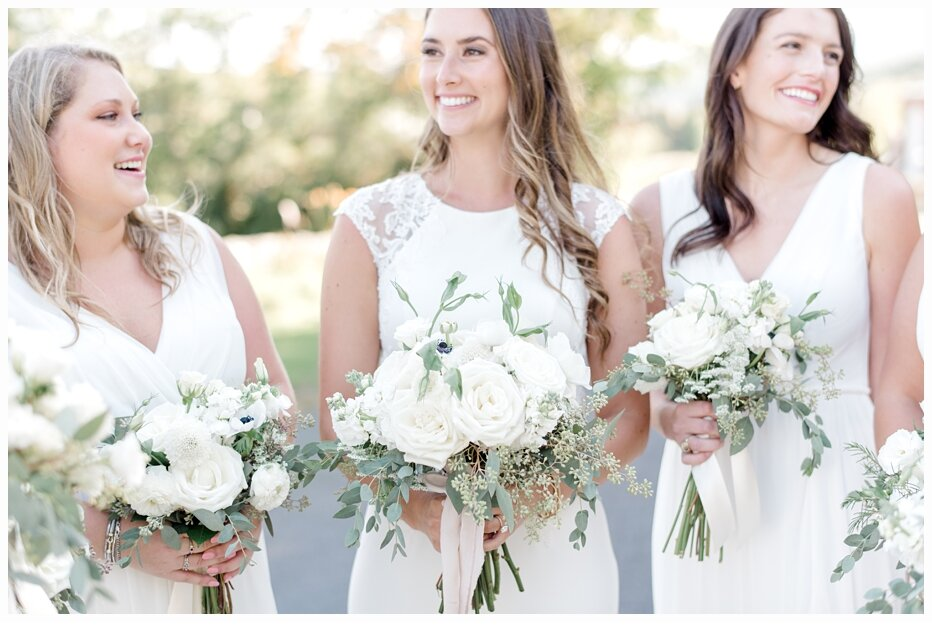 bride and bridesmaids carrying pretty bouquets