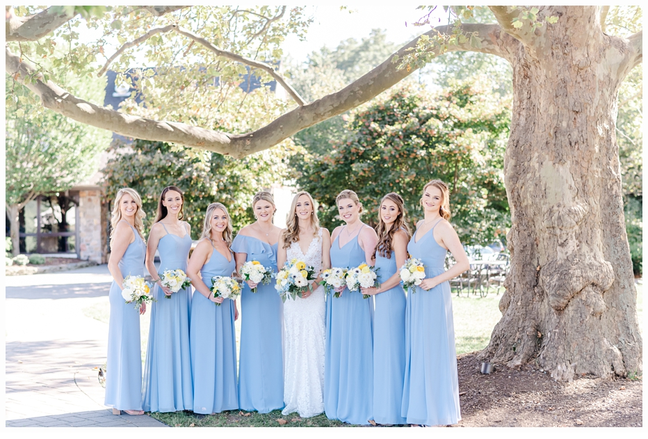 bride and bridesmaids by the lake