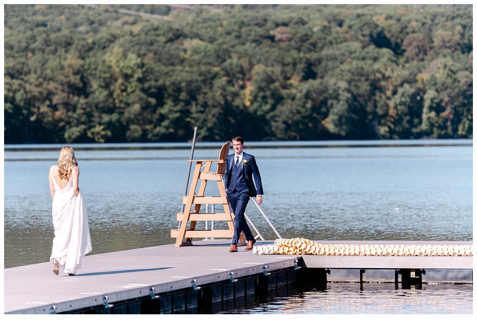 bride and groom on a dock having a first look