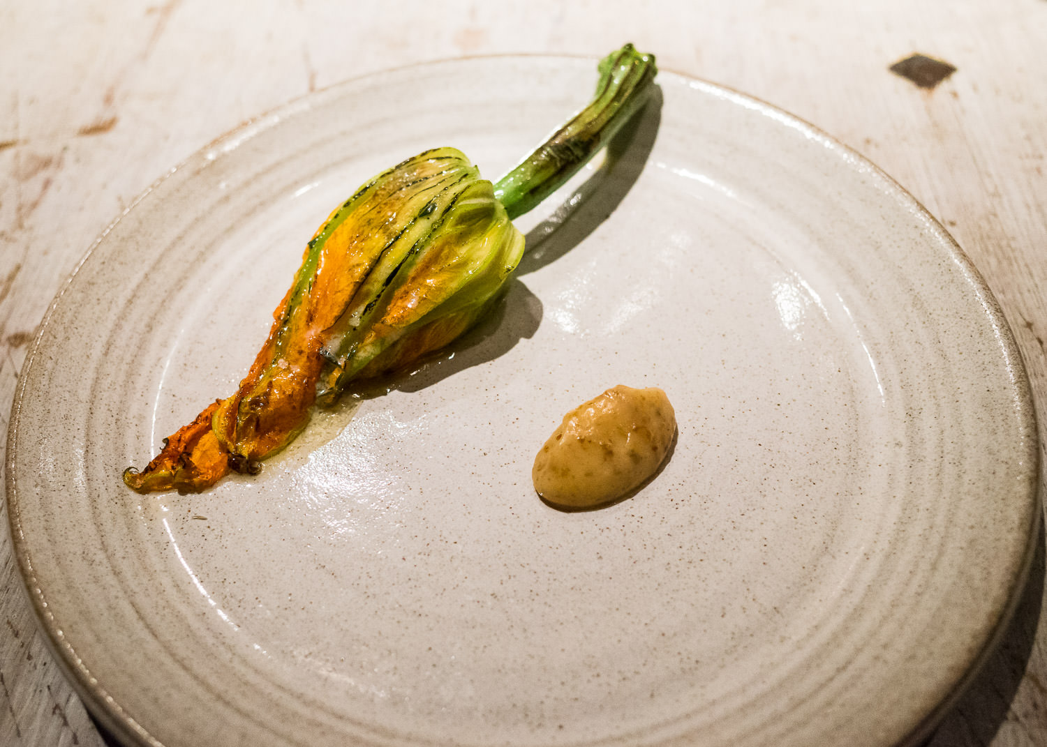 Zucchini flower and almost burnt cream (v)
