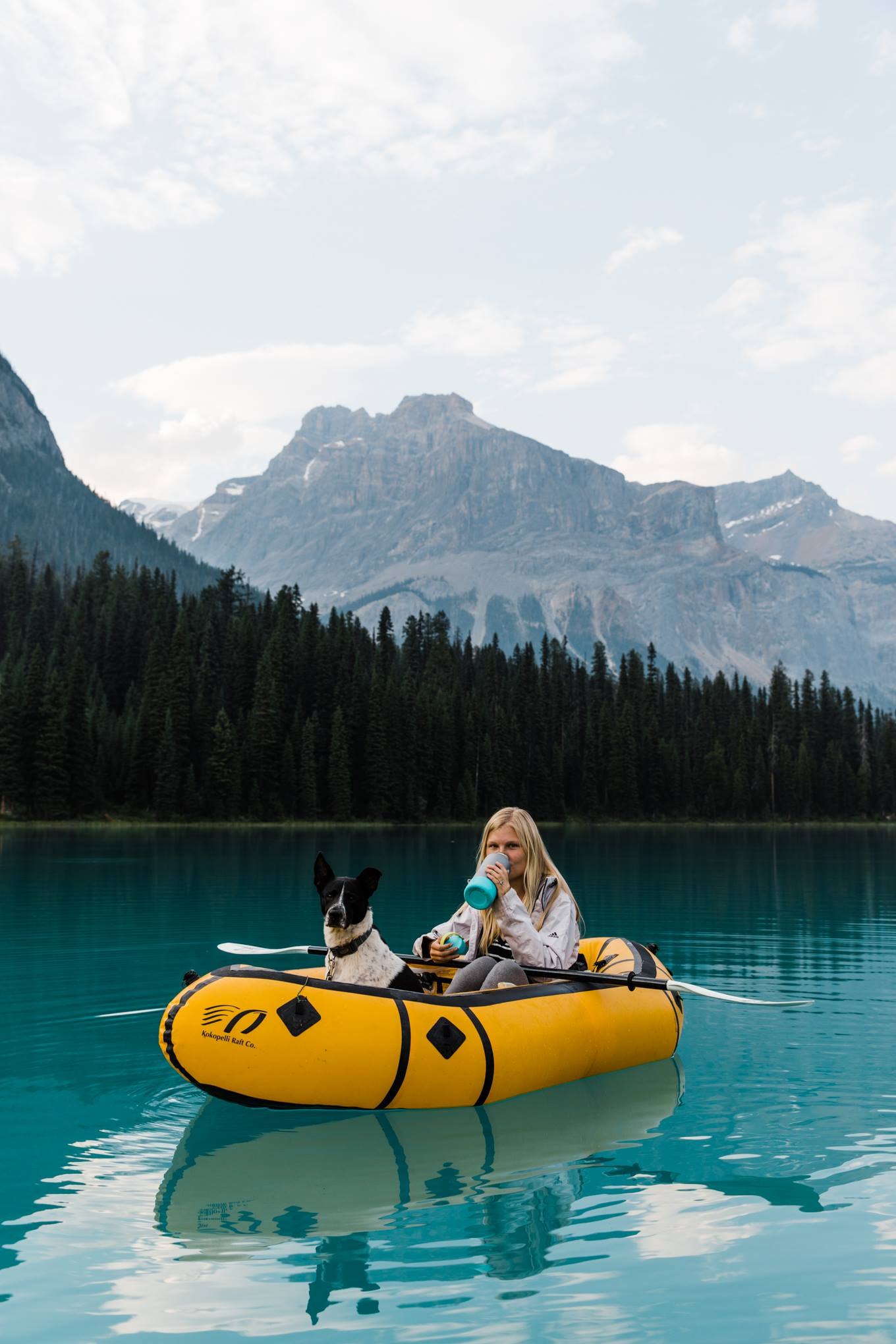 traveling photographers exploring lakes and mountains in canada