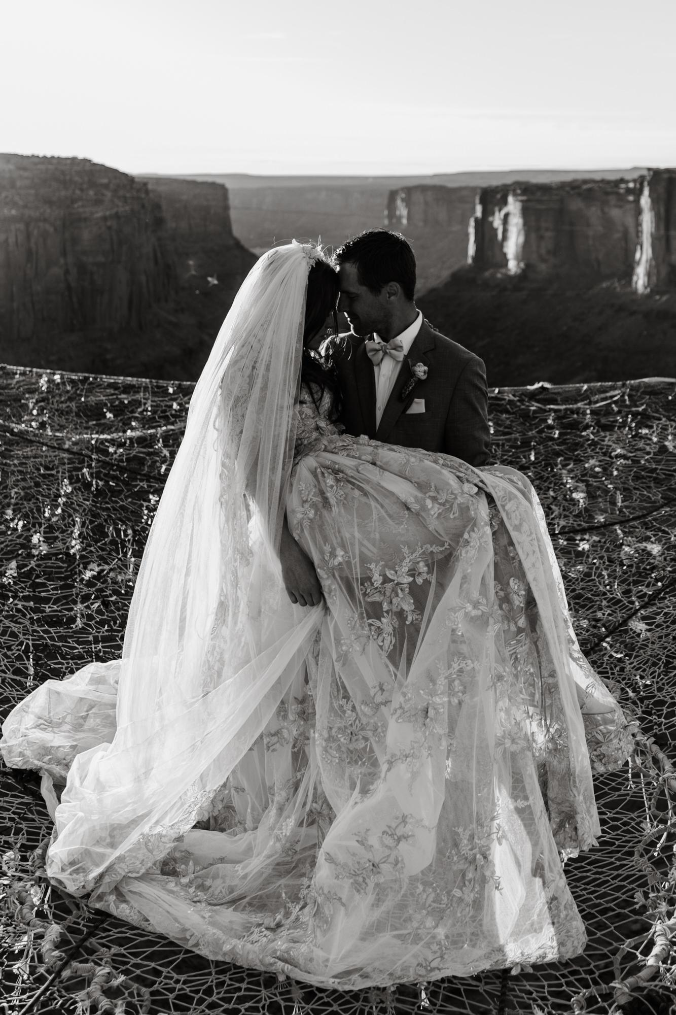spacenet wedding 400 feet above a canyon in moab, utah | adventurous desert elopement | galia lahav bride | the hearnes adventure wedding photography | www.thehearnes.com
