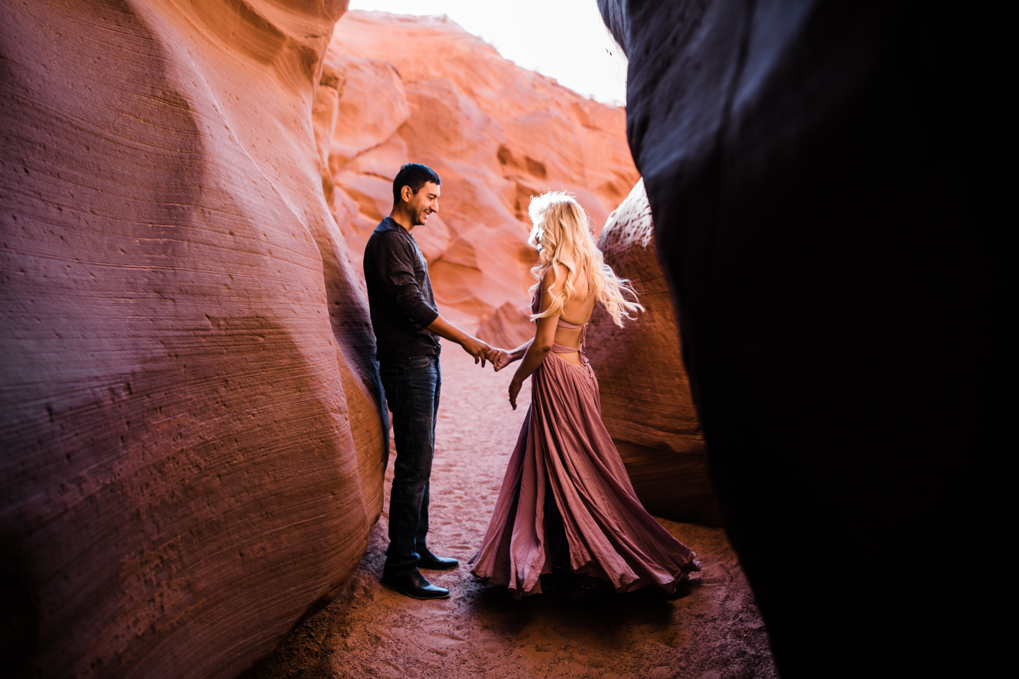 adventure elopement session in antelope canyon | destination engagement photo inspiration | utah adventure elopement photographers | the hearnes adventure photography | www.thehearnes.com