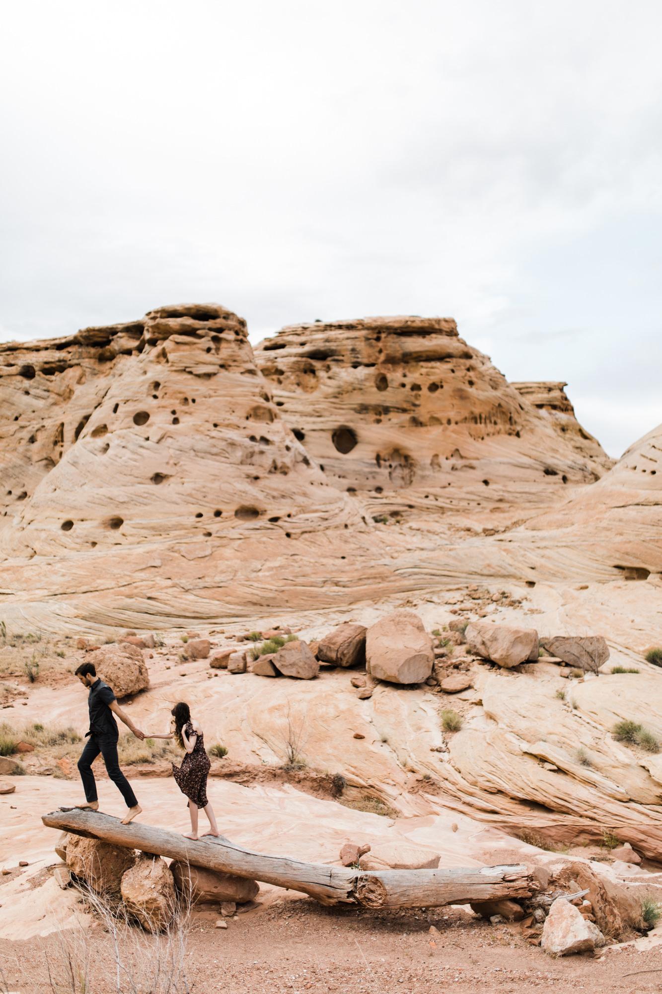adventure engagement session in the utah desert  | destination engagement photo inspiration | utah adventure elopement photographers | the hearnes adventure photography | www.thehearnes.com