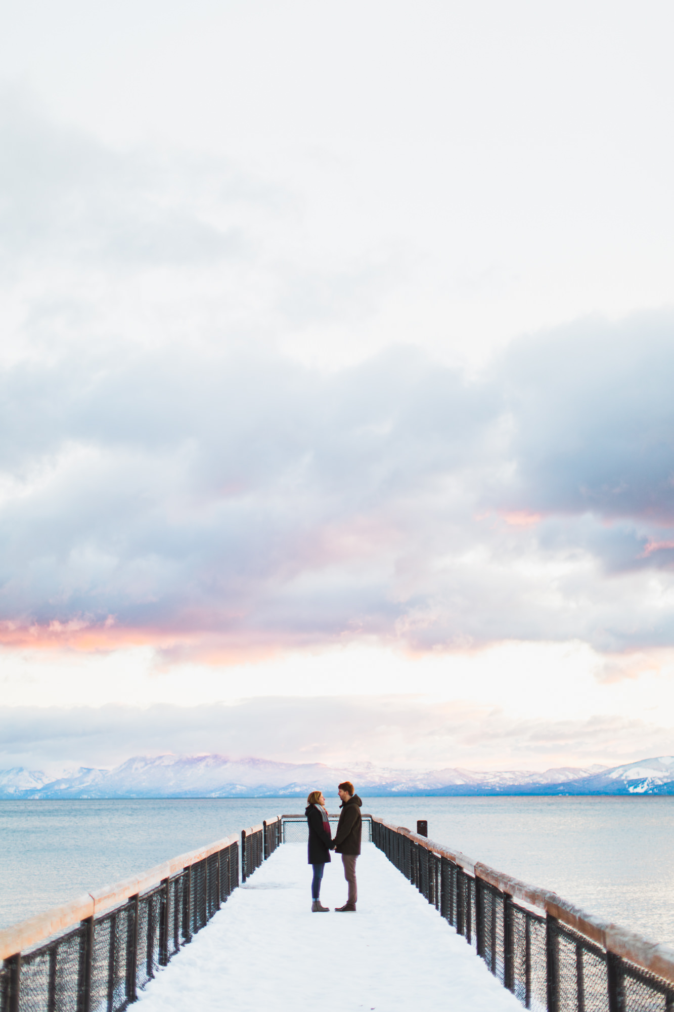 snowy engagement session on lake tahoe | destination engagement photo inspiration | utah adventure elopement photographers | the hearnes adventure photography | www.thehearnes.com