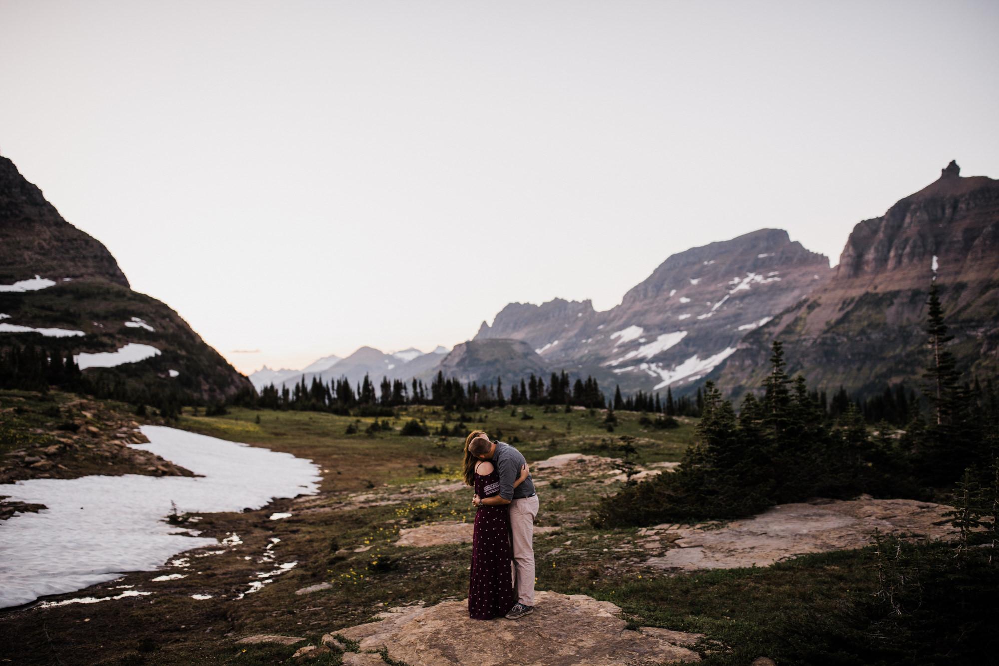 mountain top adventure session in glacier national park | destination engagement photo inspiration | utah adventure elopement photographers | the hearnes adventure photography | www.thehearnes.com