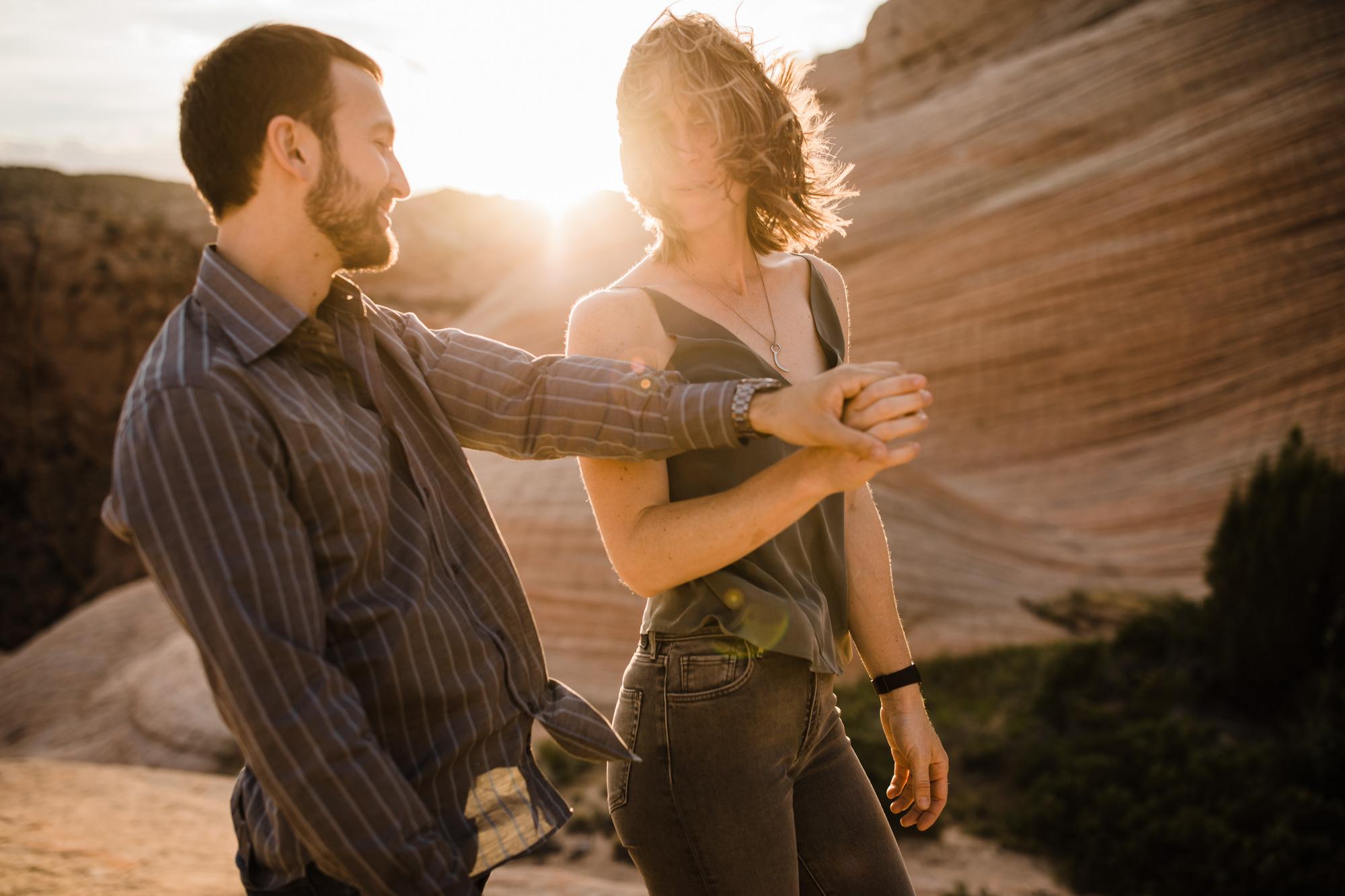 windy engagement session in the utah desert | destination engagement photo inspiration | utah adventure elopement photographers | the hearnes adventure photography | www.thehearnes.com