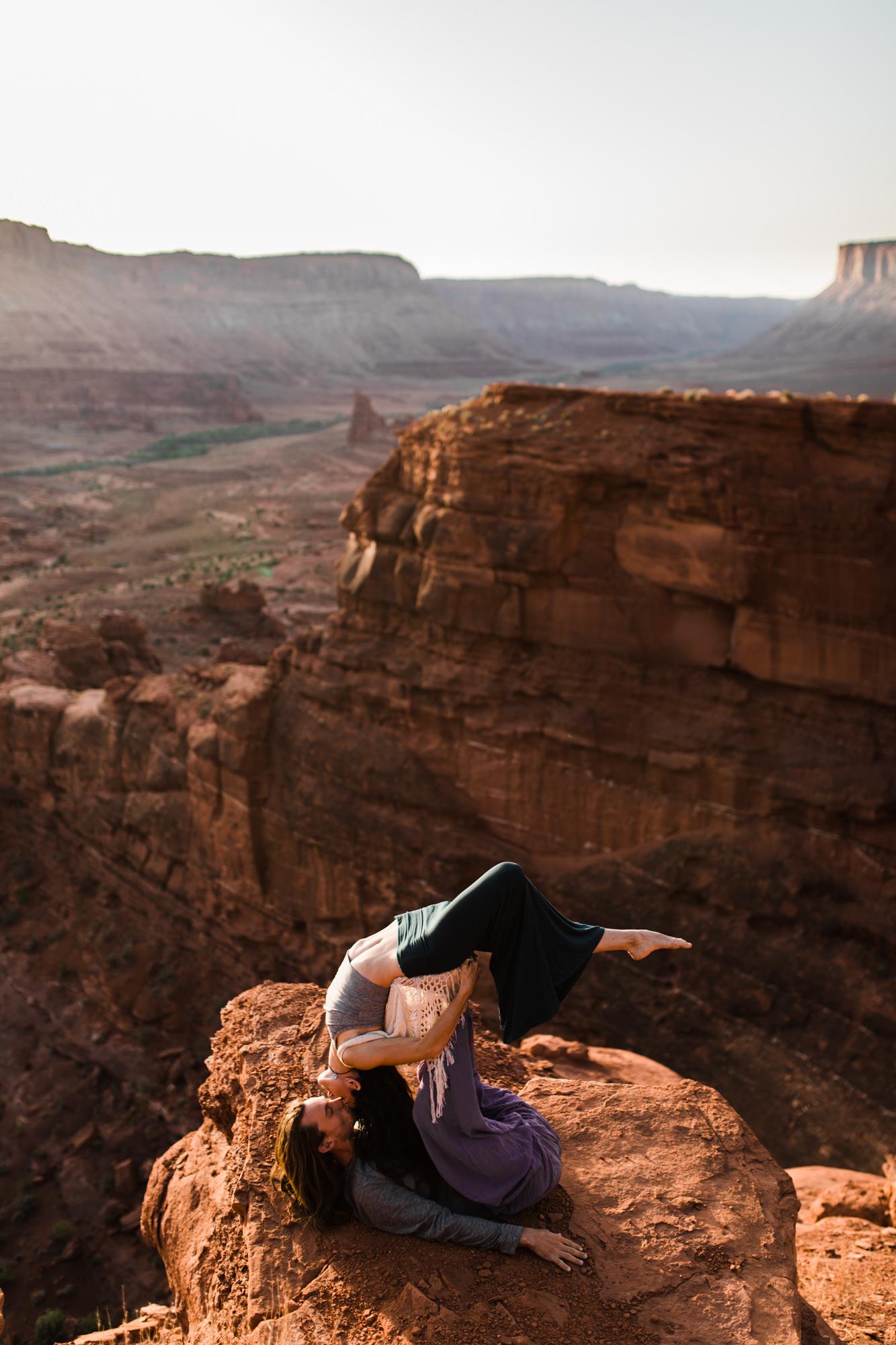 epic acro yoga engagements in moab, utah | destination engagement photo inspiration | utah adventure elopement photographers | the hearnes adventure photography | www.thehearnes.com