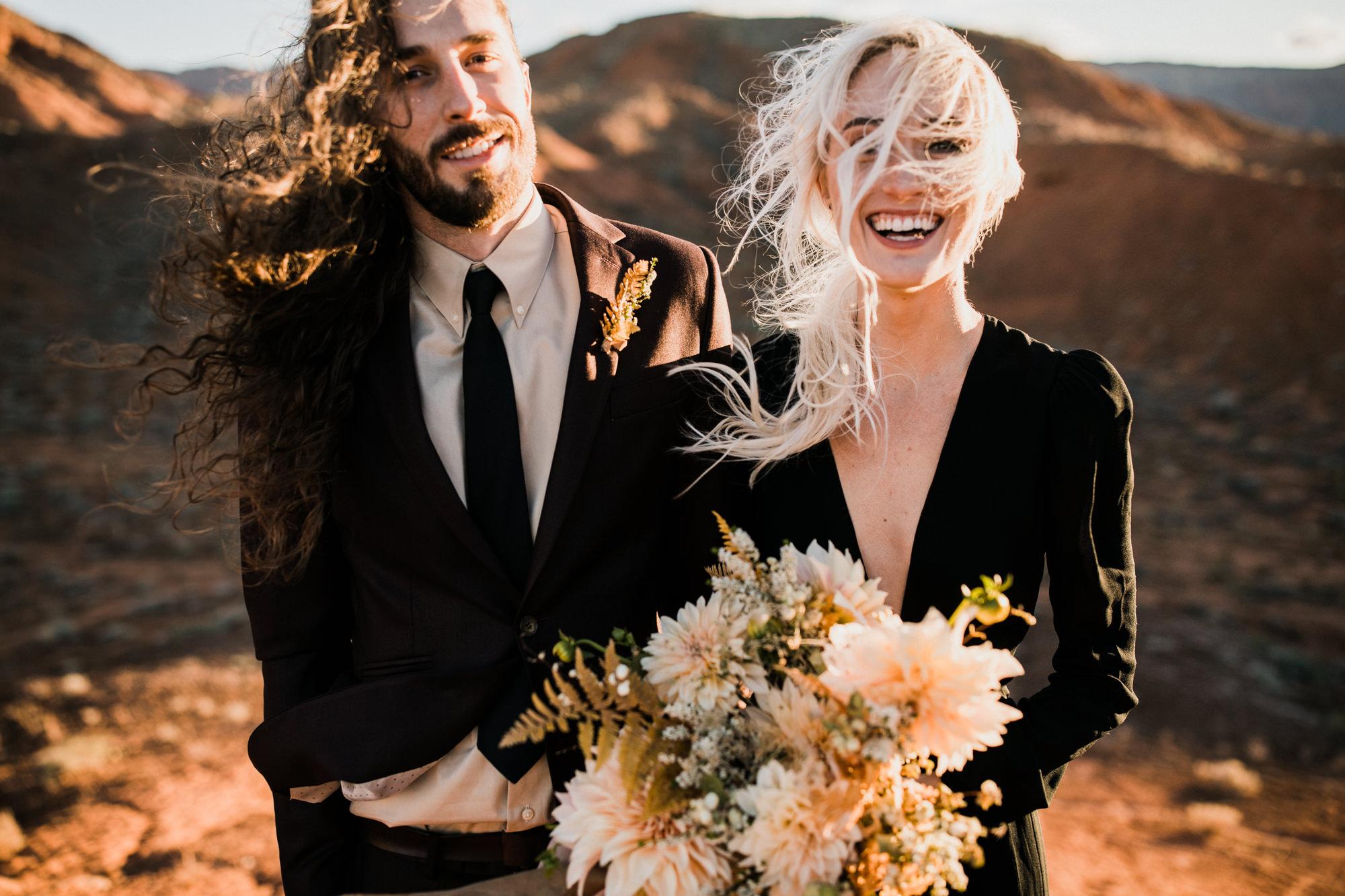 elopement in moab, utah + black wedding dress | destination adventure wedding photographers | the hearnes adventure photography | www.thehearnes.com