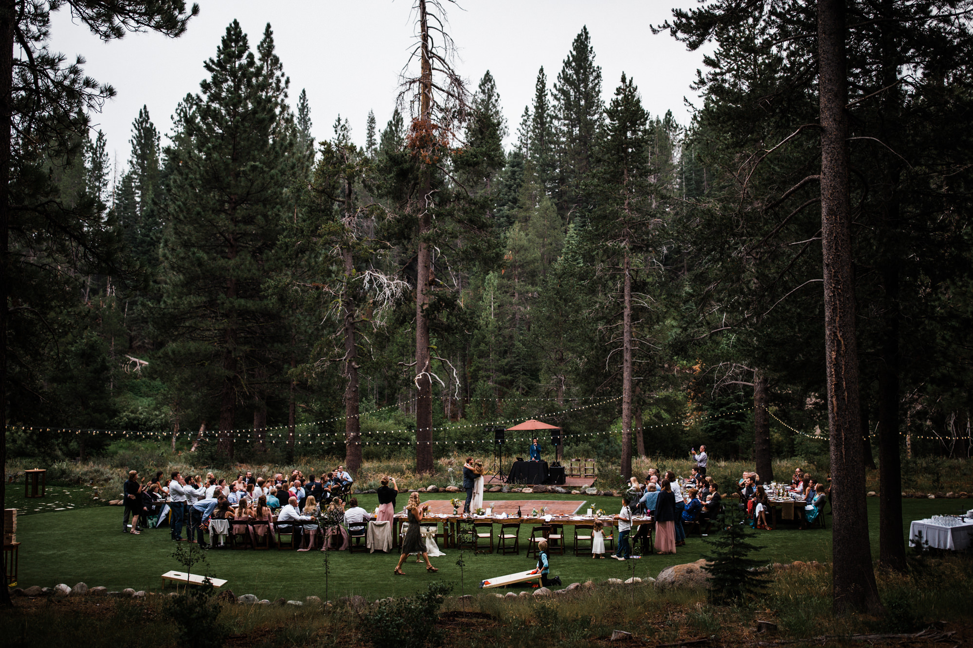 intimate reception in the woods near lake tahoe, california | destination adventure wedding photographers | the hearnes adventure photography | www.thehearnes.com
