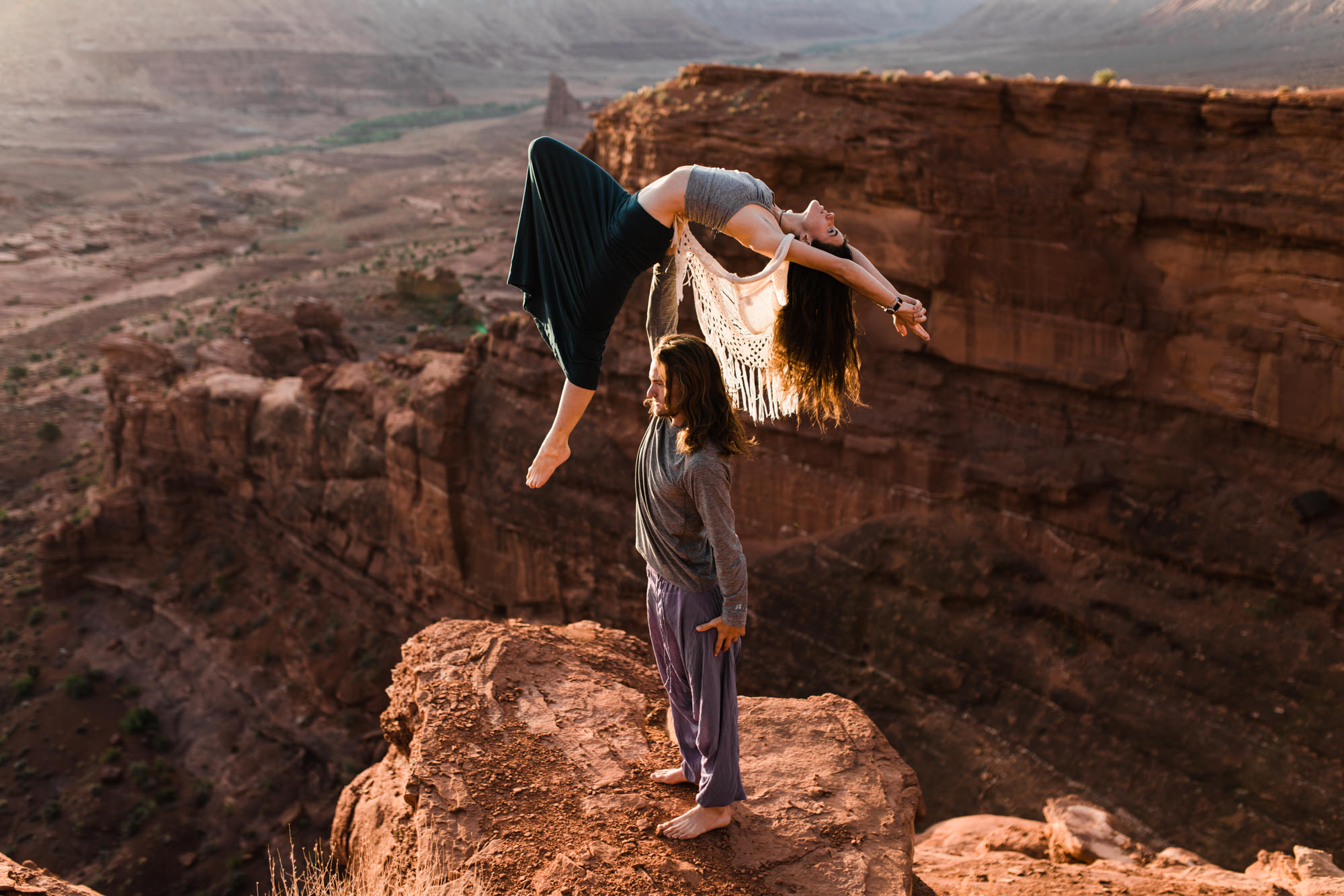 Adventurous engagement session on a cliff in moab utah