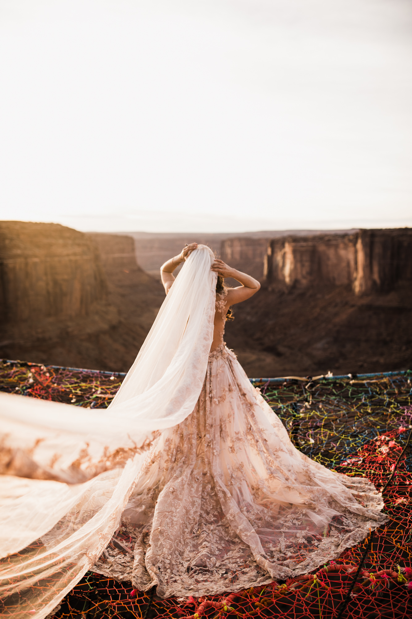 galia lahav bride on a moab spacenet over a canyon