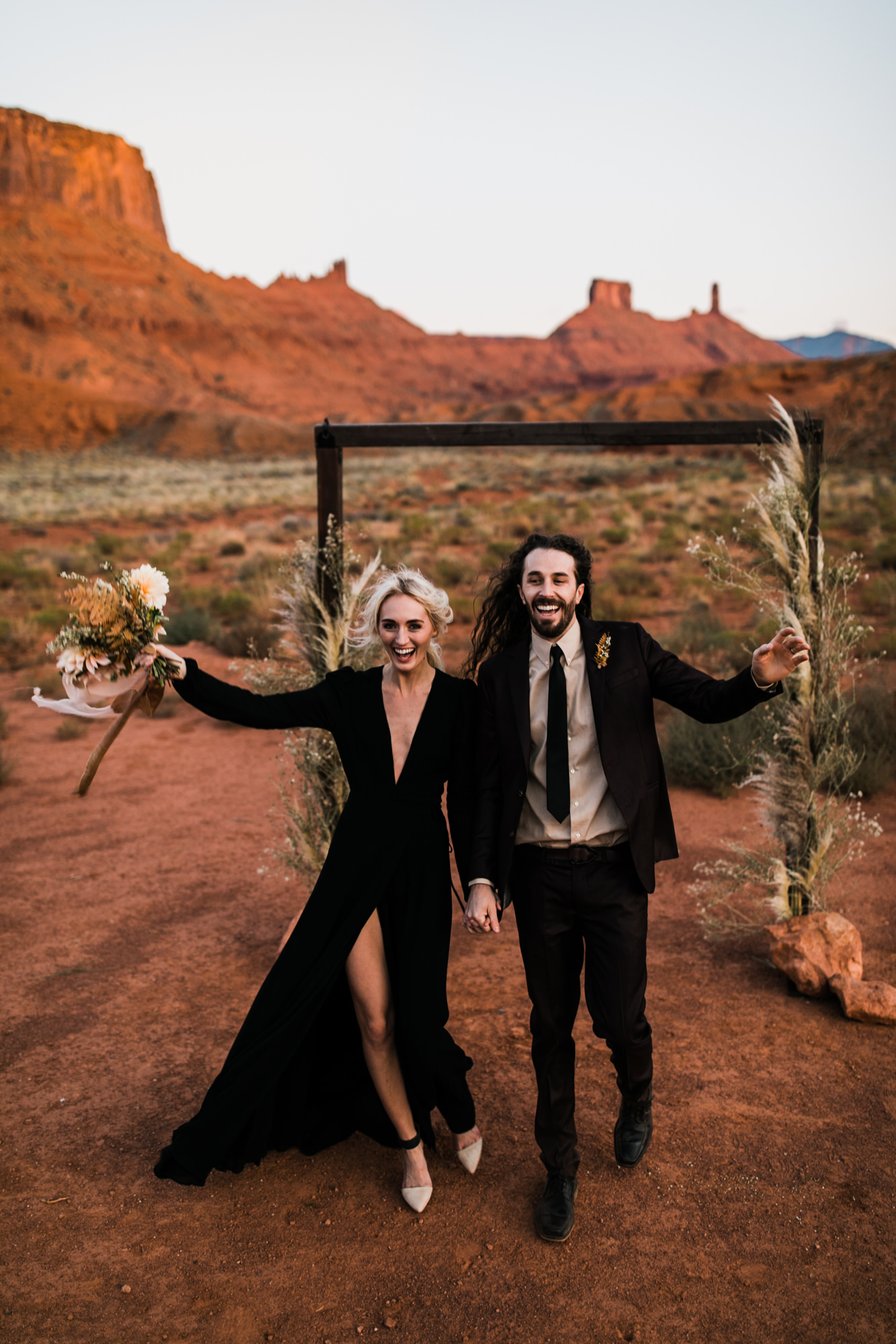 moab utah elopement with a bride wearing a black dress