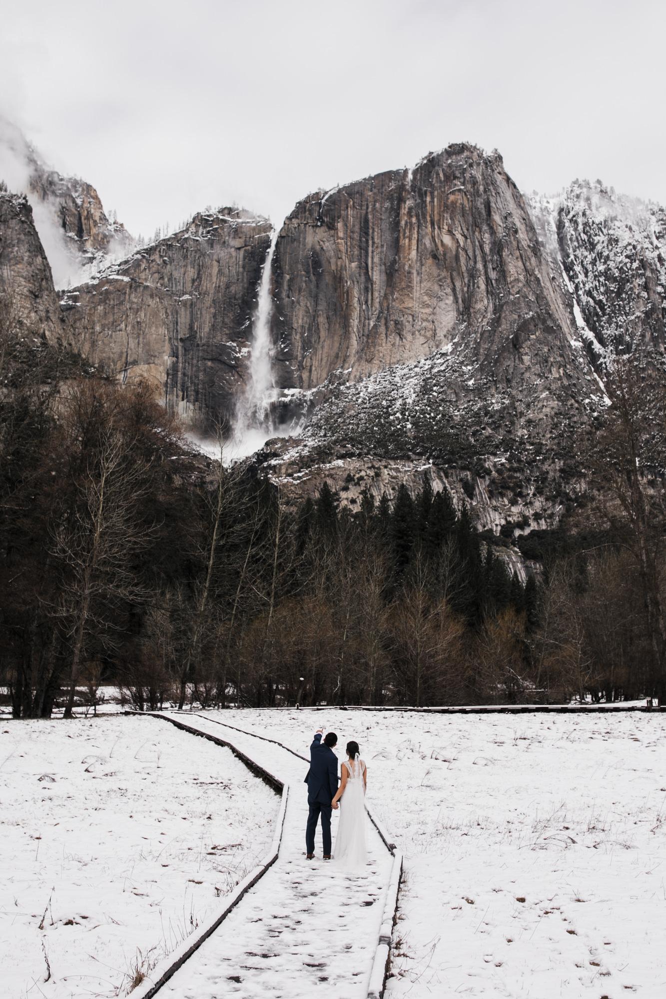 snowy waterfall elopement in yosemite