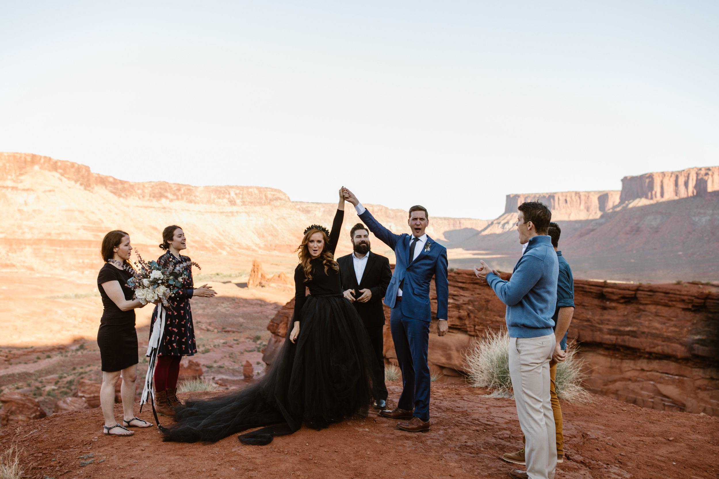 Rachelle had the best of both worlds, wearing a white wedding dress for their sunrise first look in Canyonlands National Park, and a black wedding dress for their ceremony in a secret canyon near Moab, Utah.  Click here to see the full blog post from their Moab elopement!