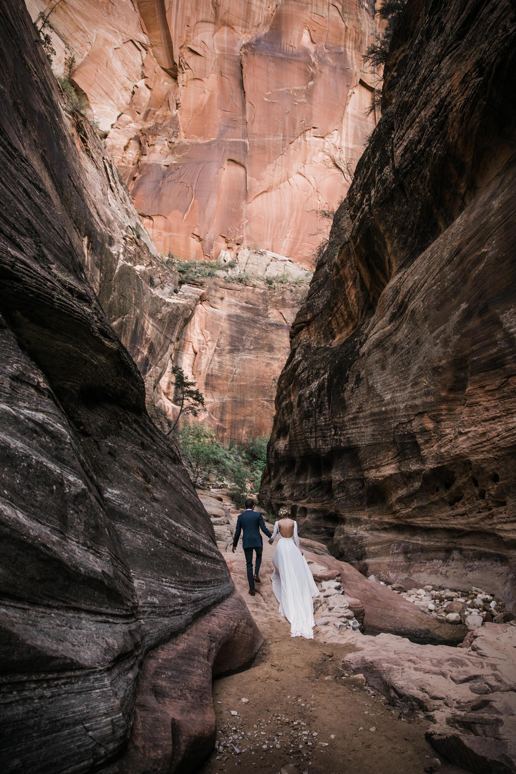 erin + marshall's sunrise elopement ceremony overlooking zion national park   hiking wedding   utah elopement photographer   the hearnes adventure photography