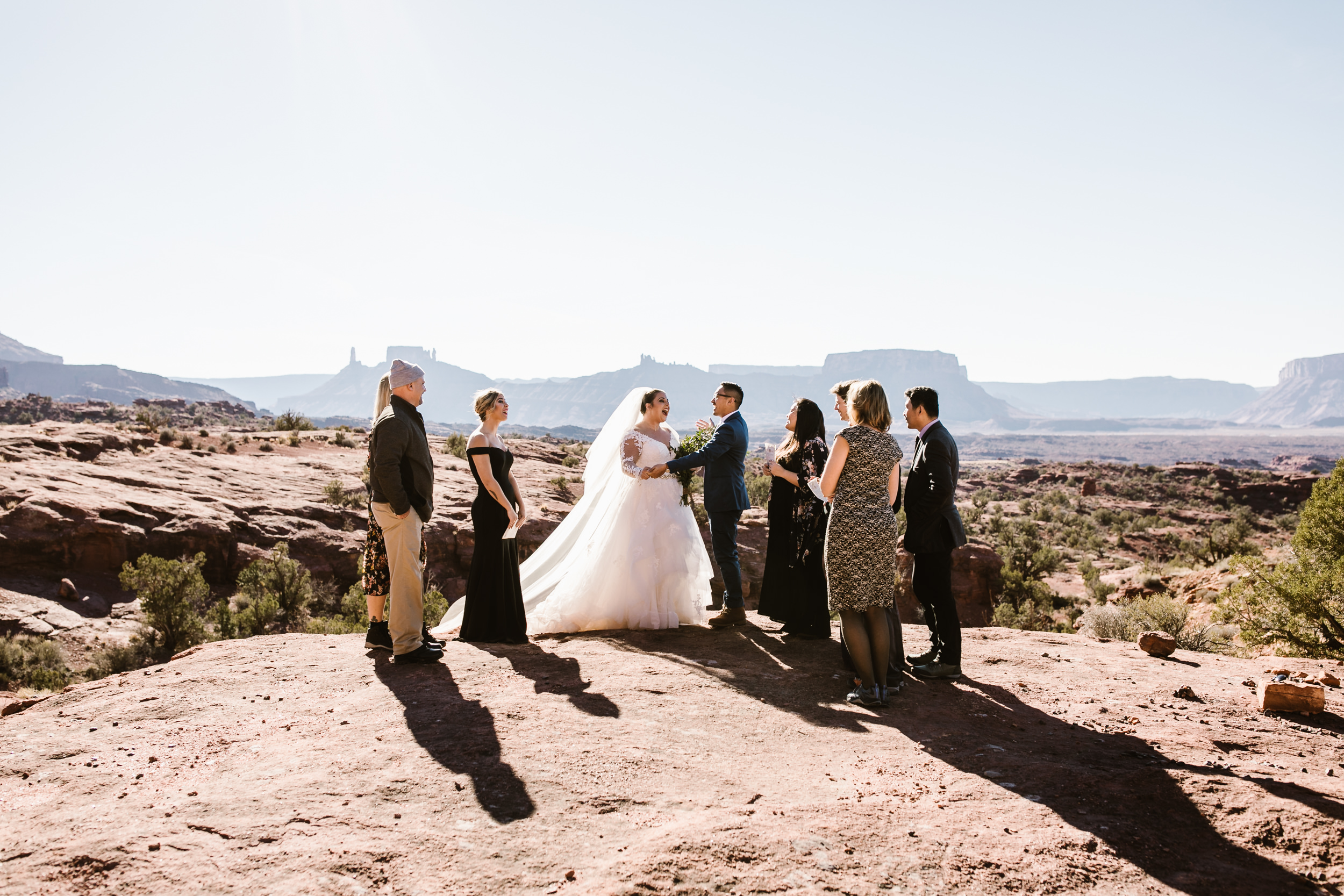 intimate family-only wedding day in moab, utah | arches national park elopement first look | ceremony in the desert | the hearnes adventure photography
