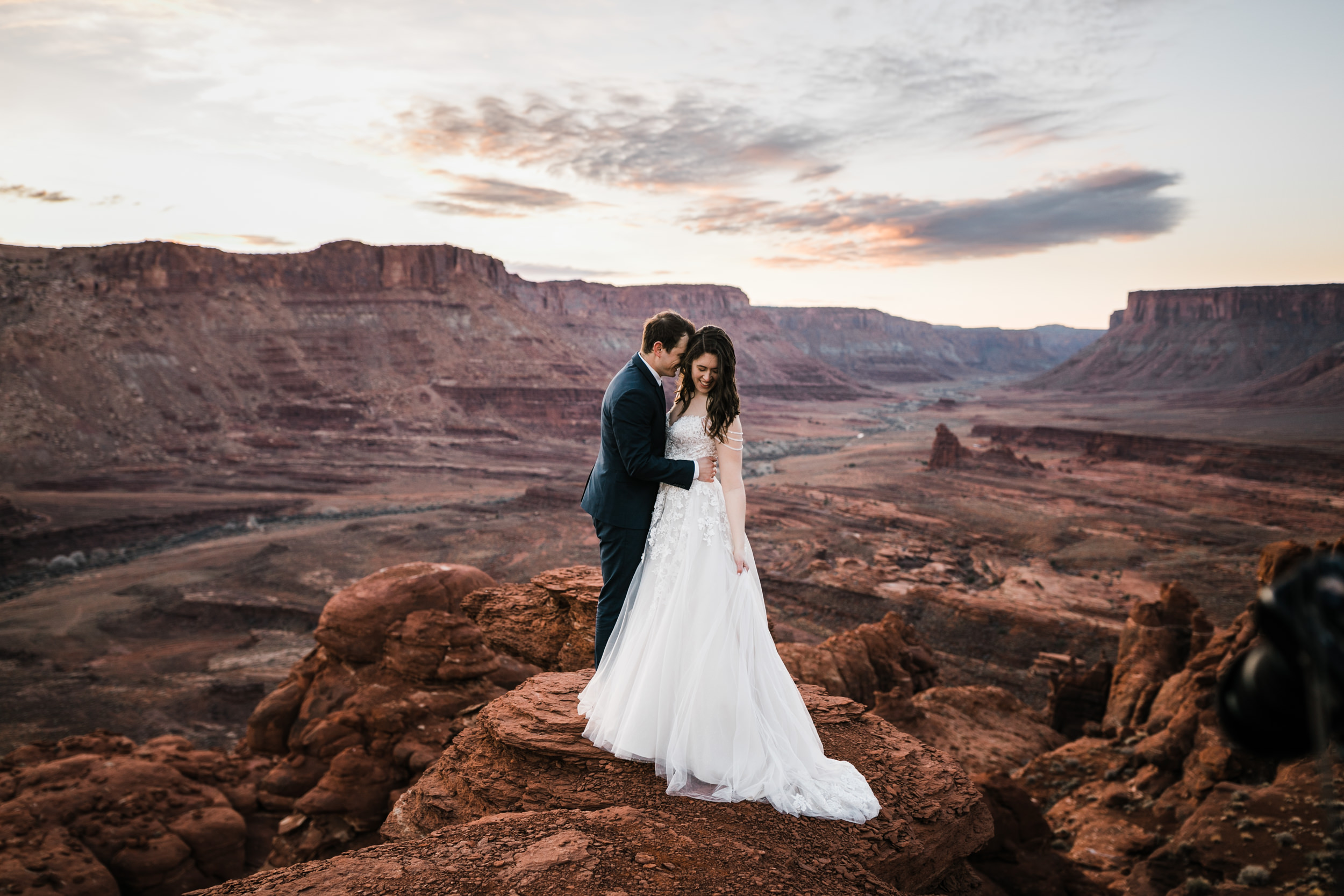 Claire's wedding dress was so beautiful. The weather was amazing in Moab this morning and make for a perfect sunrise.