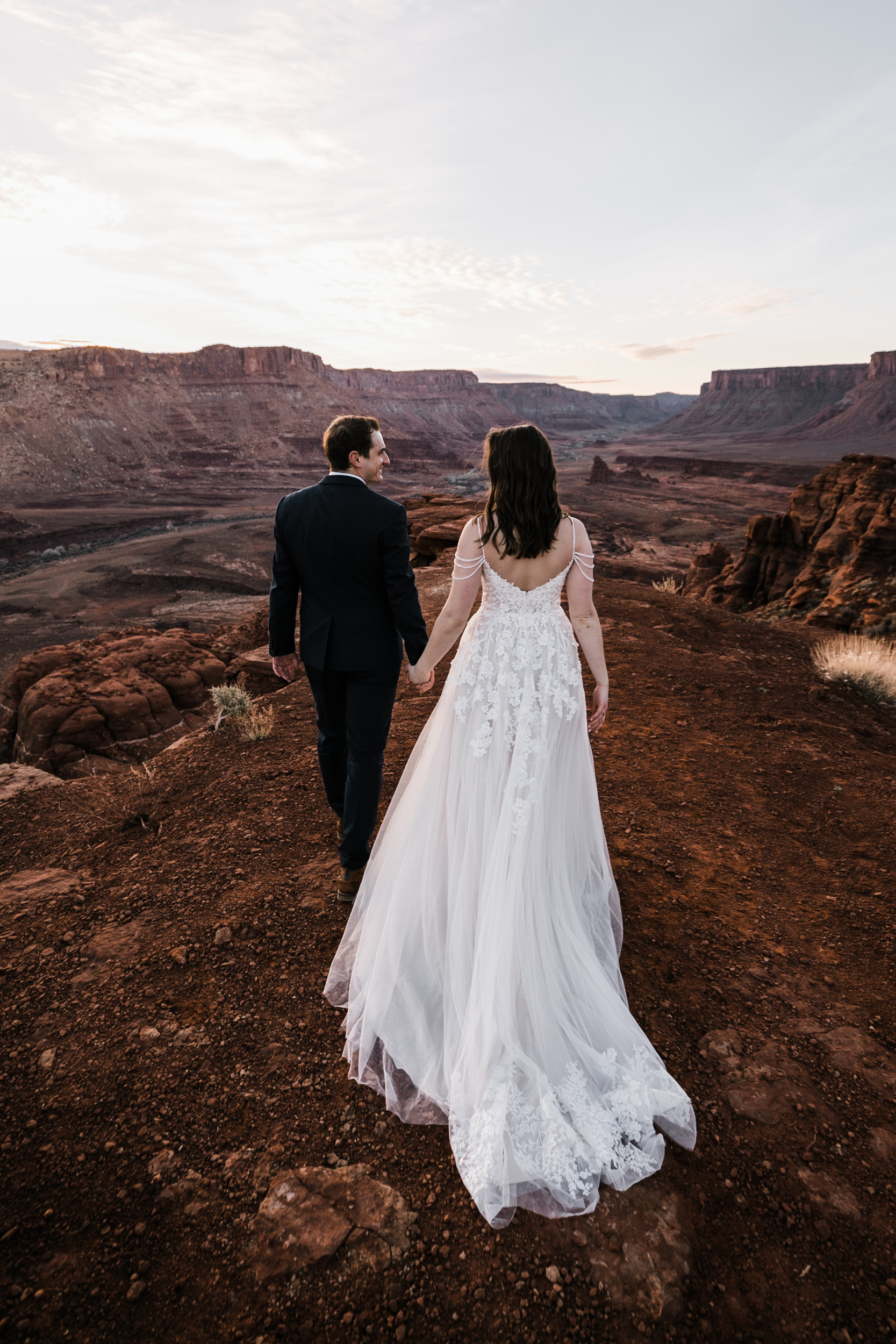 Claire's wedding dress was amazing and fit right in to the desert. Our hiking brides are so much fun!