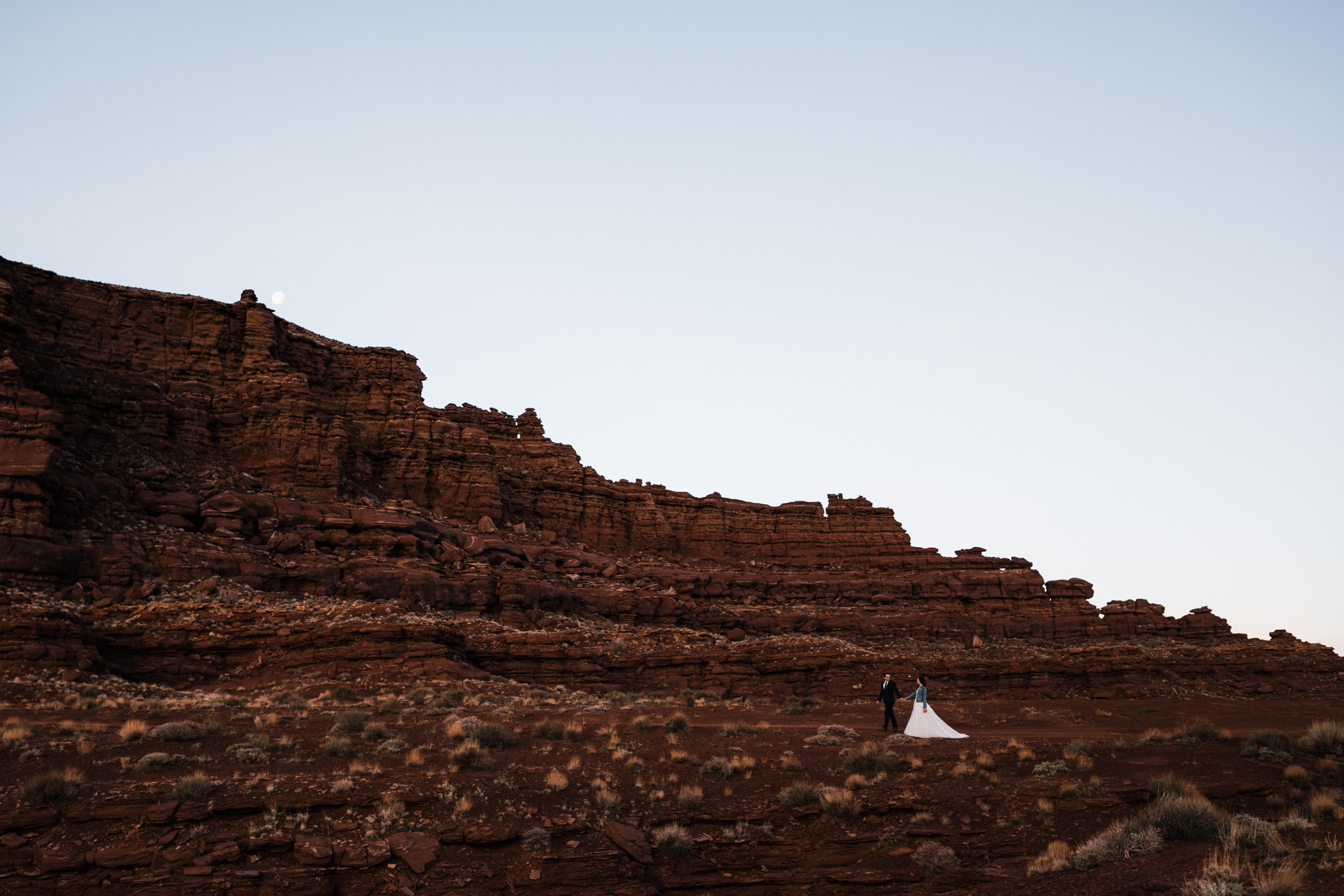 Taking a step back to take in the beautiful scenery Moab has is a perfect start to your wedding day.