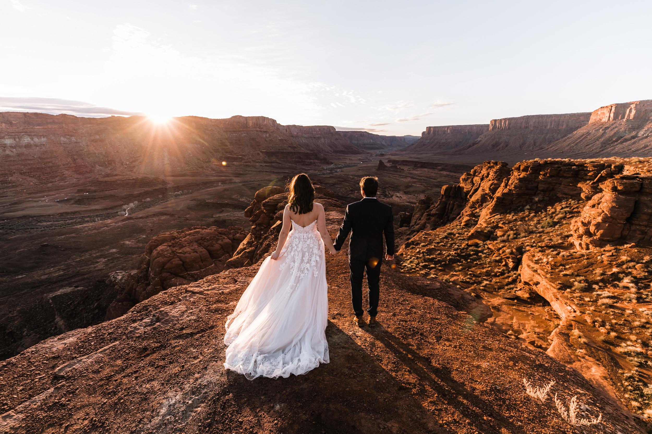 Shooting couples as the sun rises over the canyons in the desert will always be one of the most beautiful things about my job as an adventure wedding photographer!