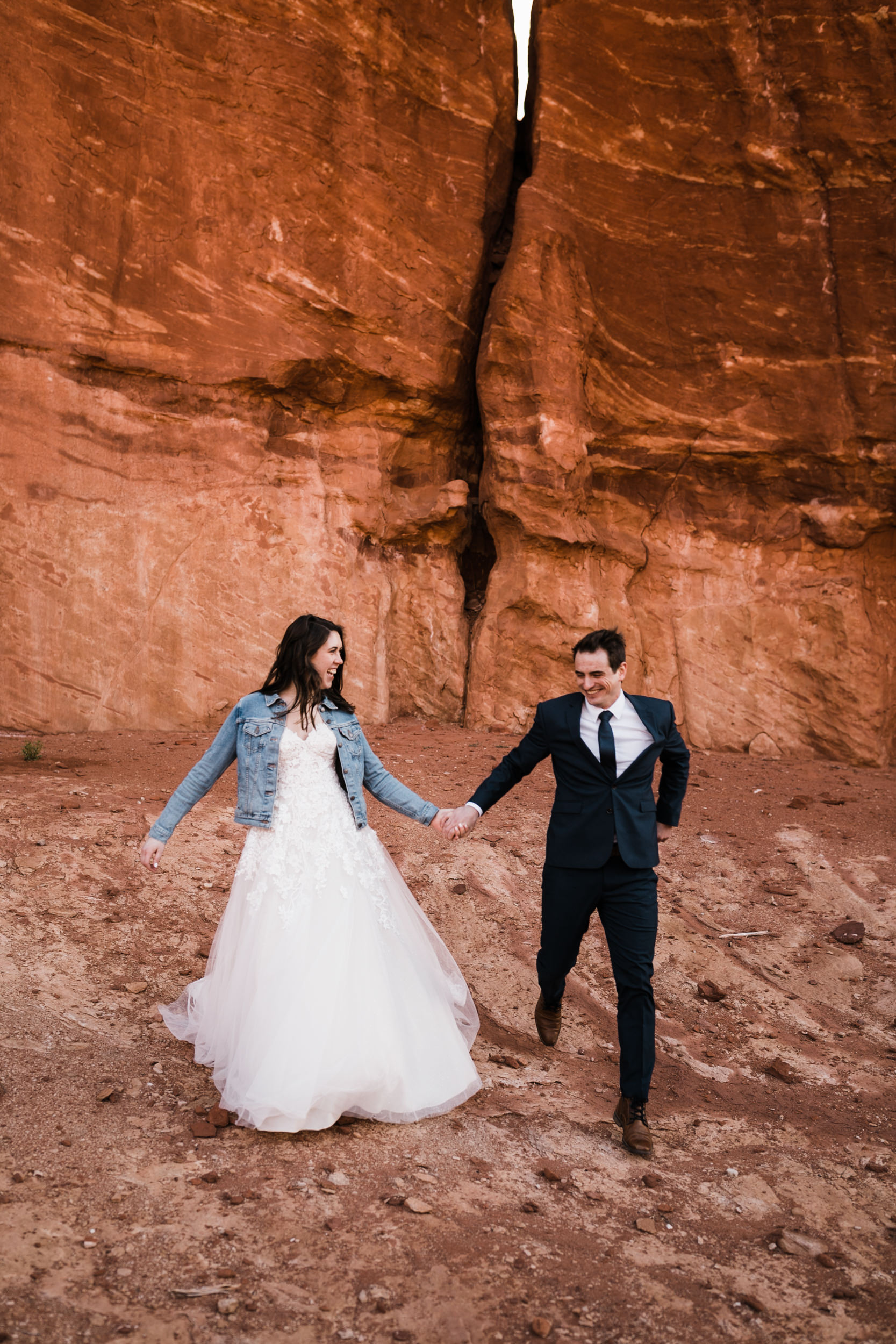 Our couples always have so much fun on their wedding day! This picture is in Moab, Utah at sunrise before their ceremony in Arches National Park.