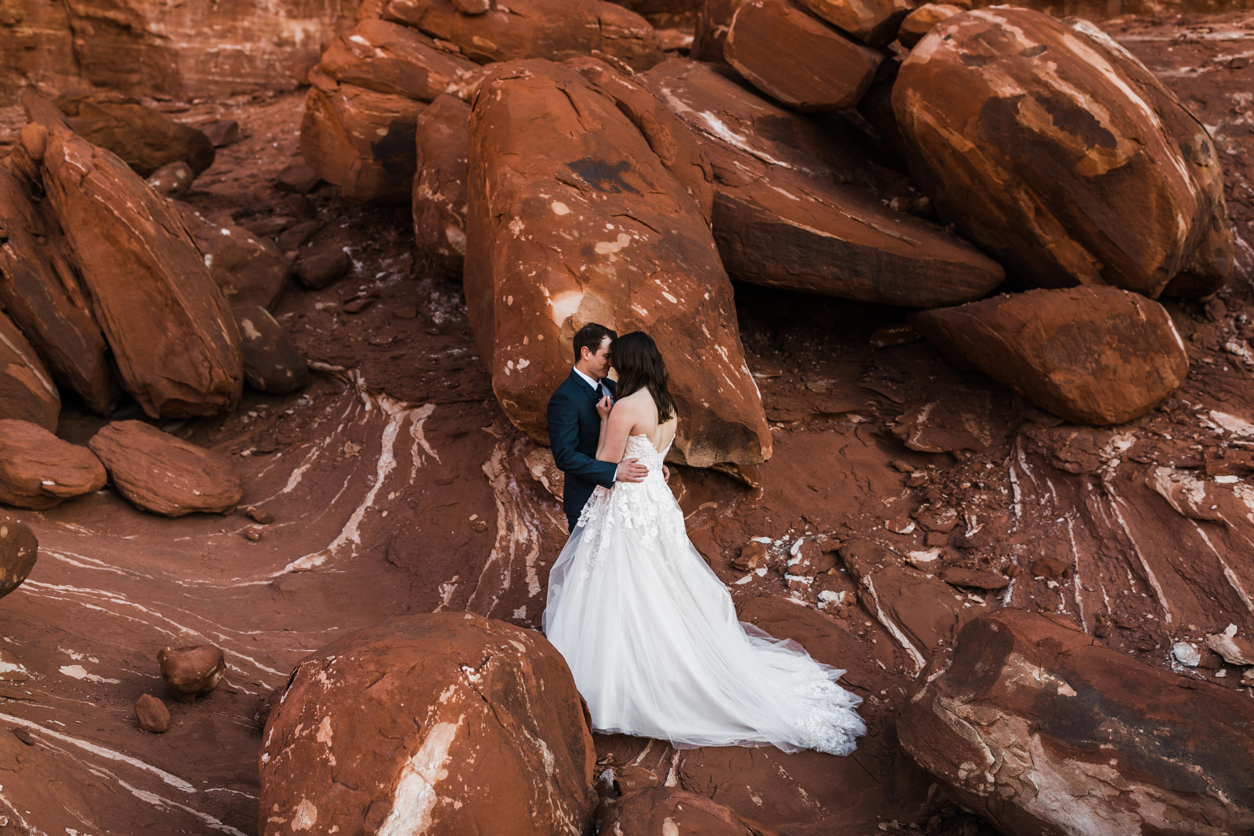 Her wedding dress was so beautiful against these red and white rocks.