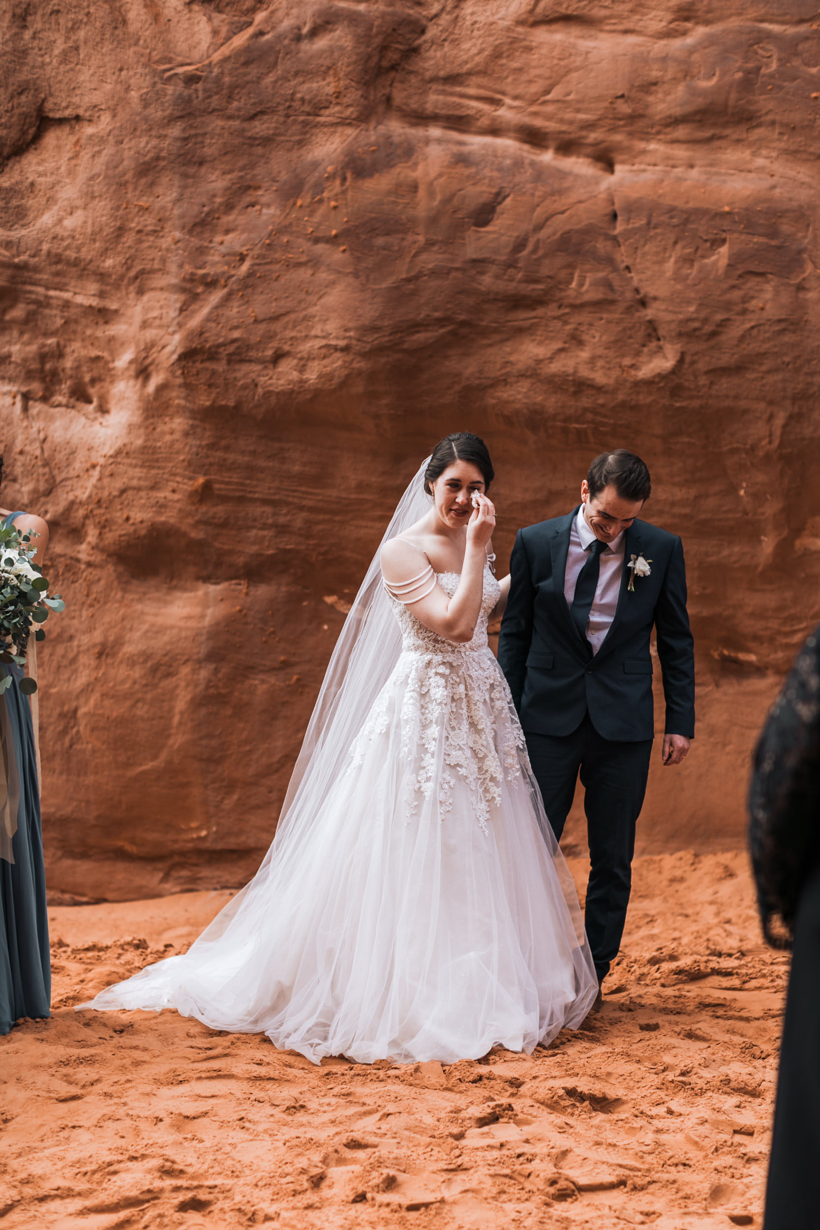 Claire teared up a little as they walked down the aisle after their elopement ceremony at Sand Dune Arch.