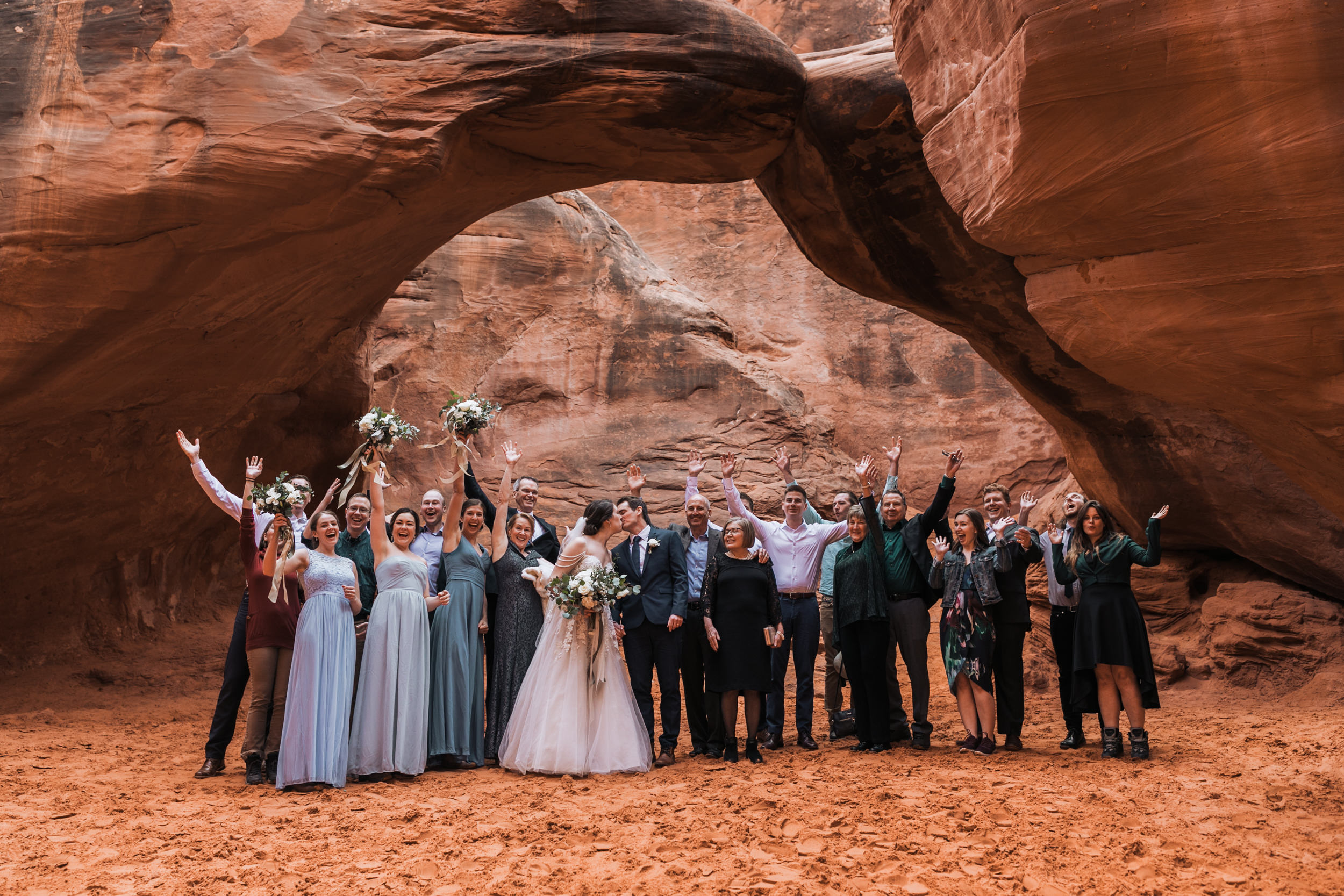 Having your wedding in a national park is so much fun! Just ask this family standing under sand dune arch.