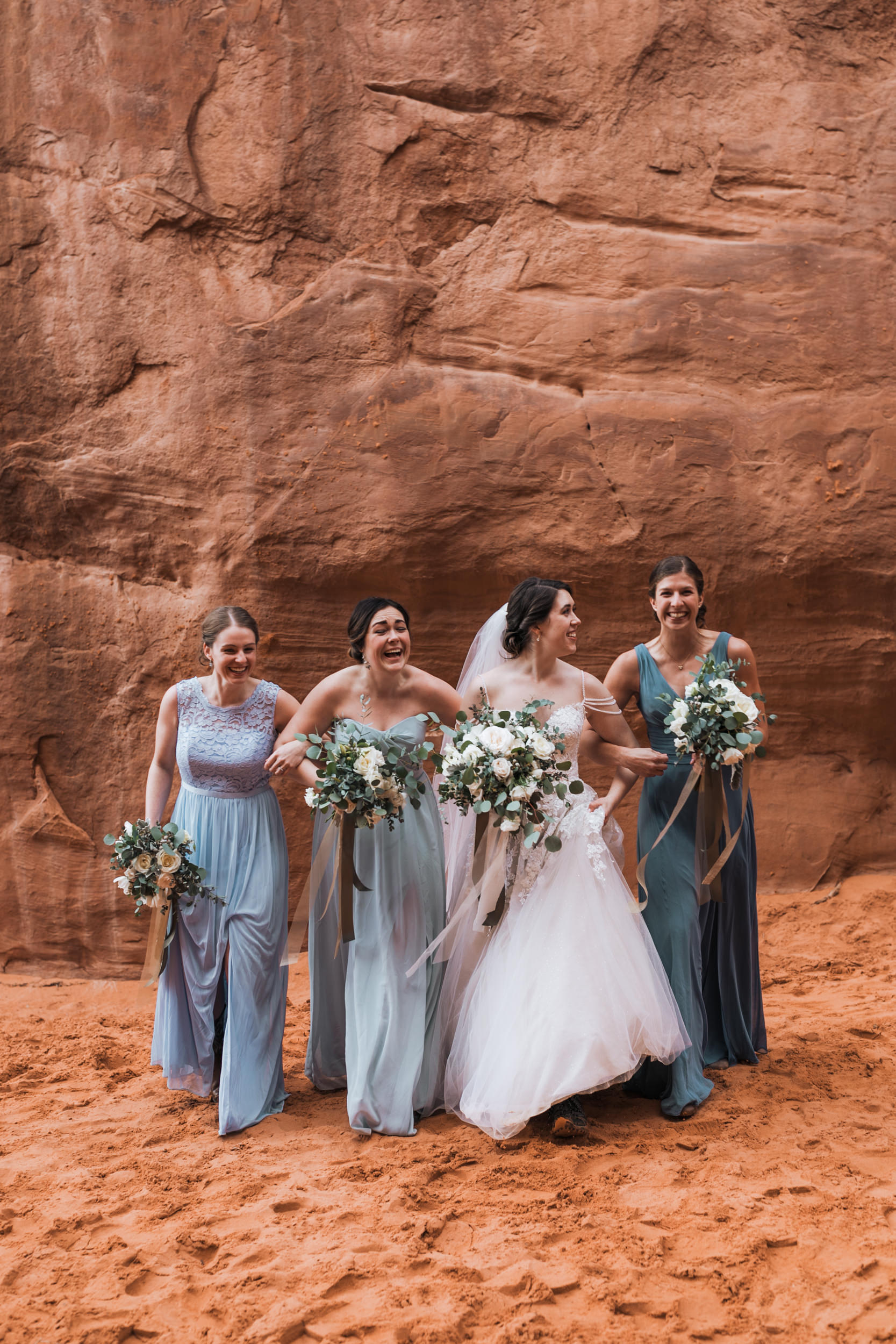 Claire and her bridesmaids enjoy a little moment together after their ceremony. It was their first time to Moab!