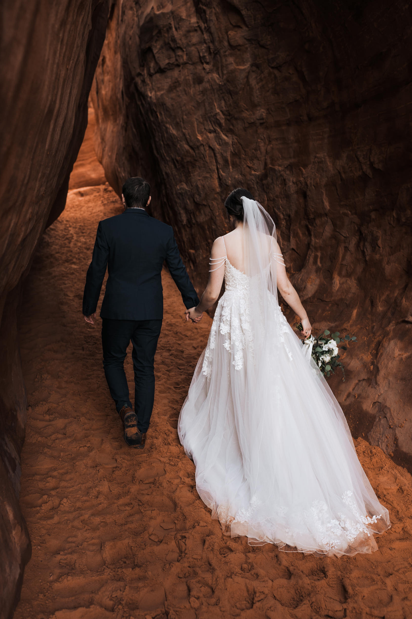 Some of the best wedding photos are little in between moments like this one when we were hiking from their ceremony to take some pictures in the Canyons of Arches National Park.