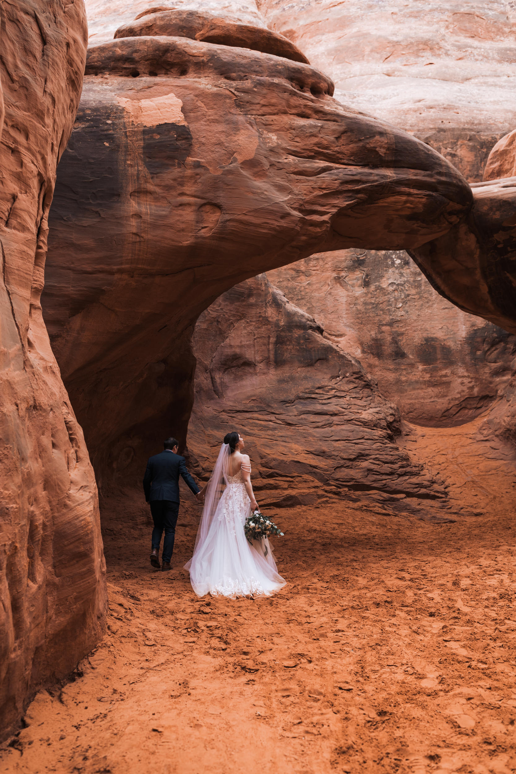 Arches National Park has a few designated wedding ceremony locations. Sand Dune arch is one. Just make sure to get your permit!