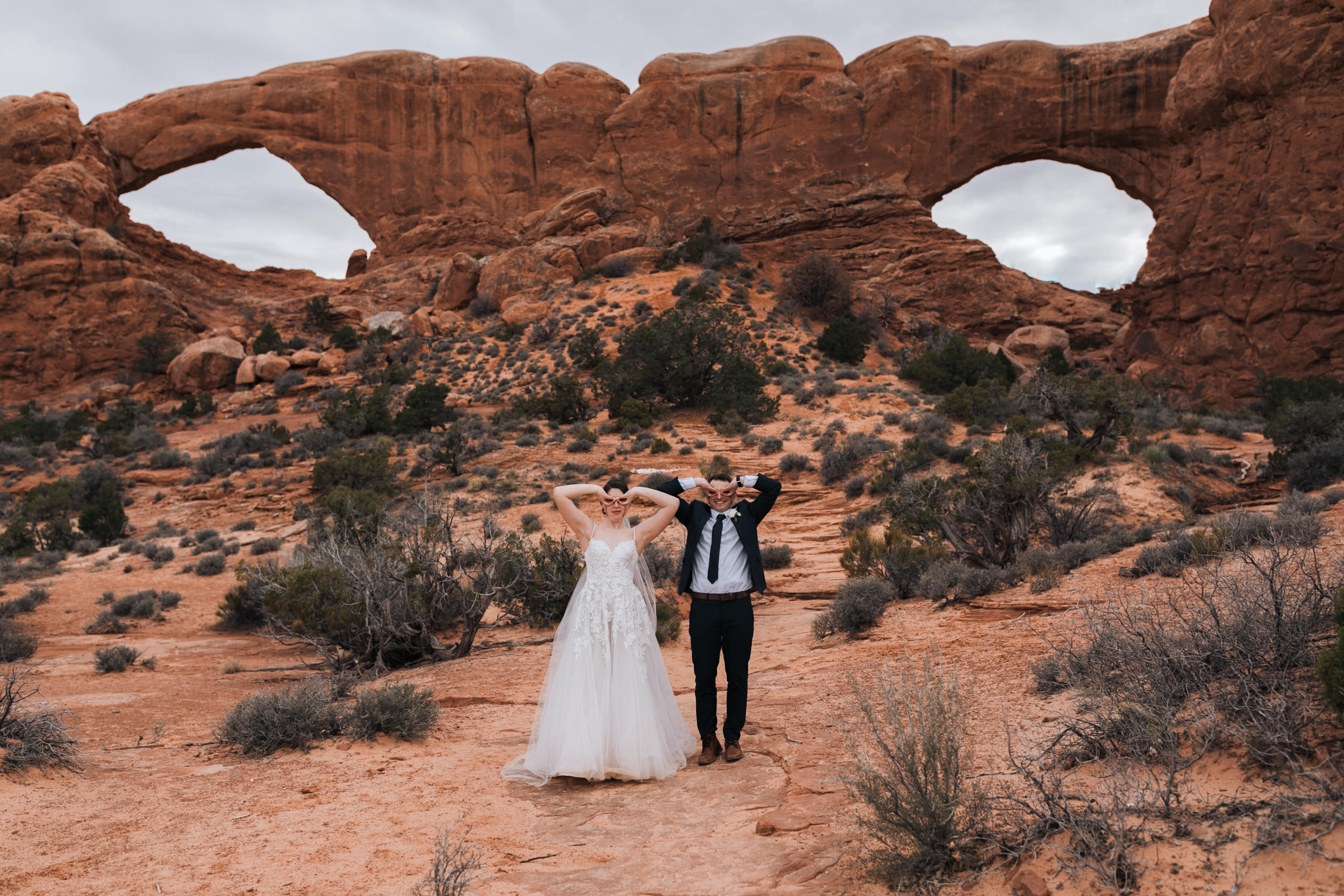 Did we mention we love the weddings we get to shoot? Our couples are so much fun - here, being goofy in front of the windows in Arches National Park.