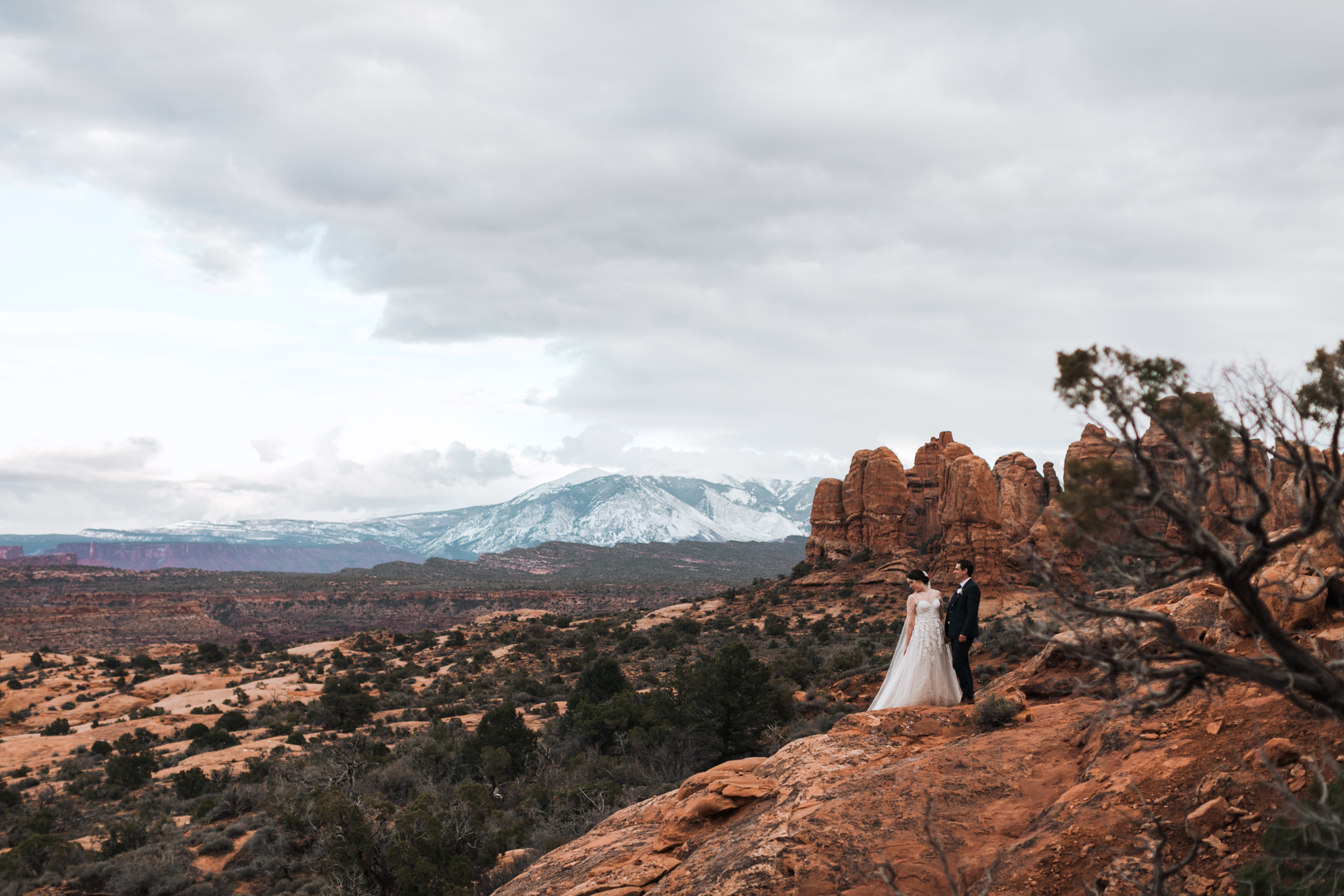 The Lasalle's in the background of Arches National Parks is one of the best desert views for sunrise or sunset in Arches National Park.