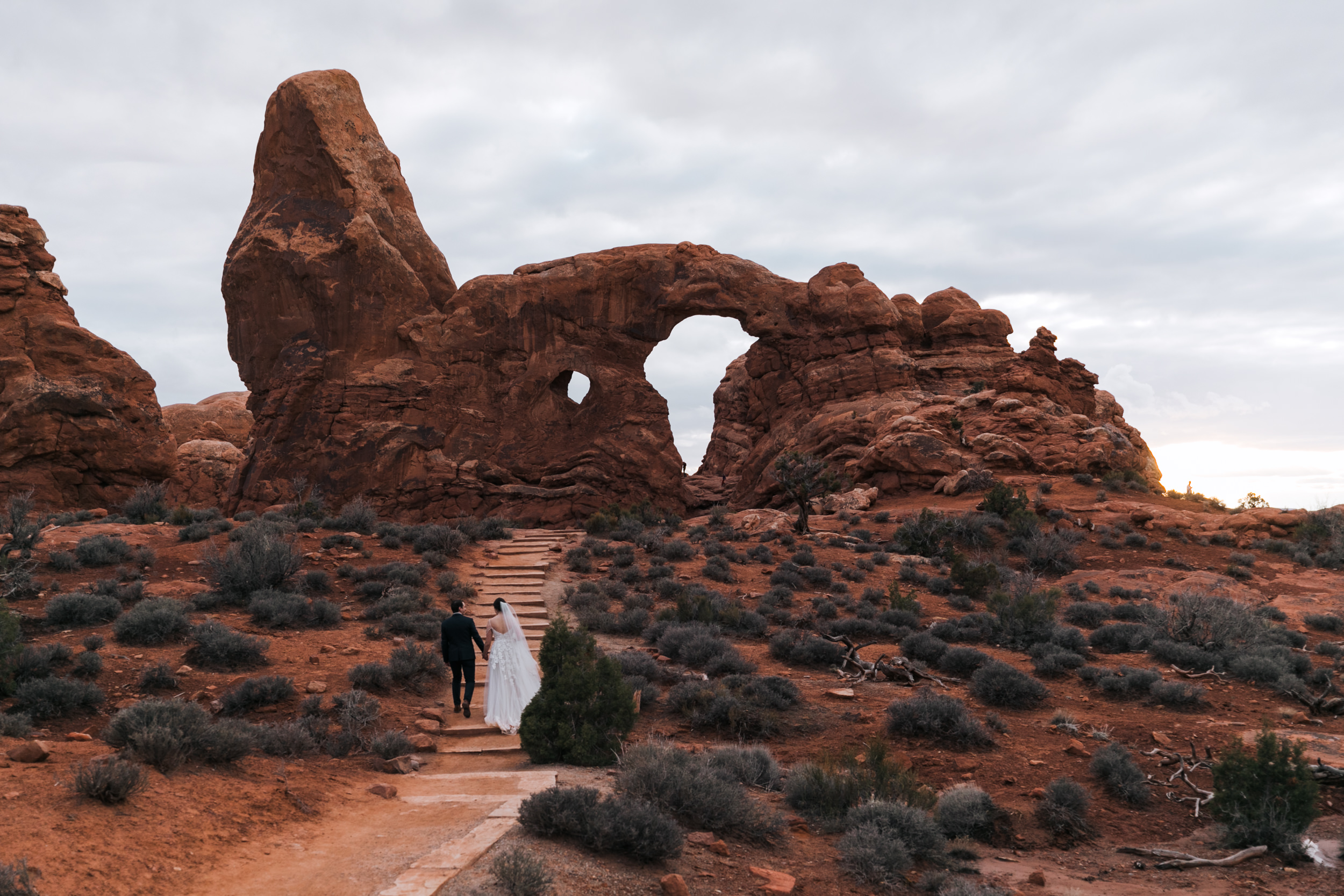Walking up the stairs to Turret Arch in Arches National Park. Double arch is just a few minute walk away.