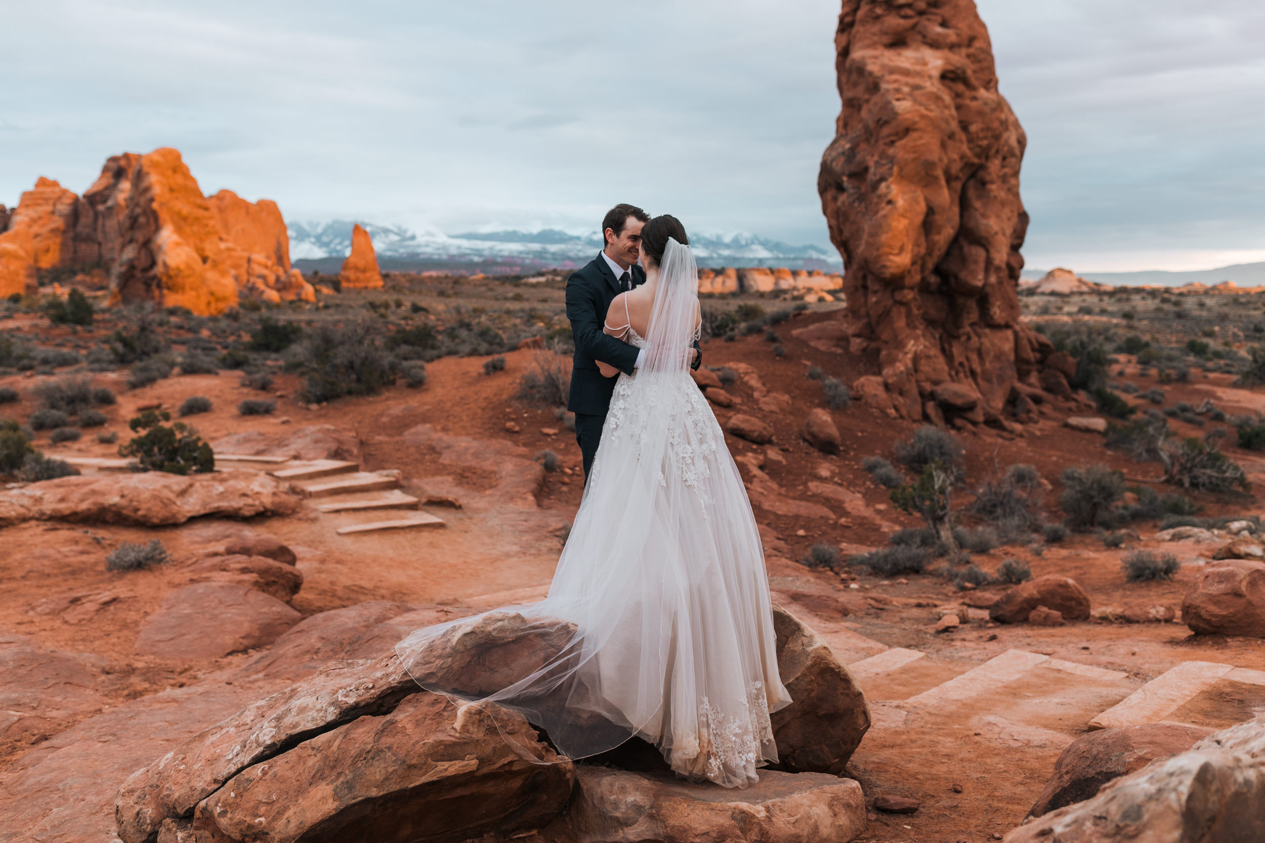 Always bittersweet shooting sunset in Moab because it's beautiful but means the day is coming to an end. These two just got married and went out for an evening hike to take photos in Arches National Park.