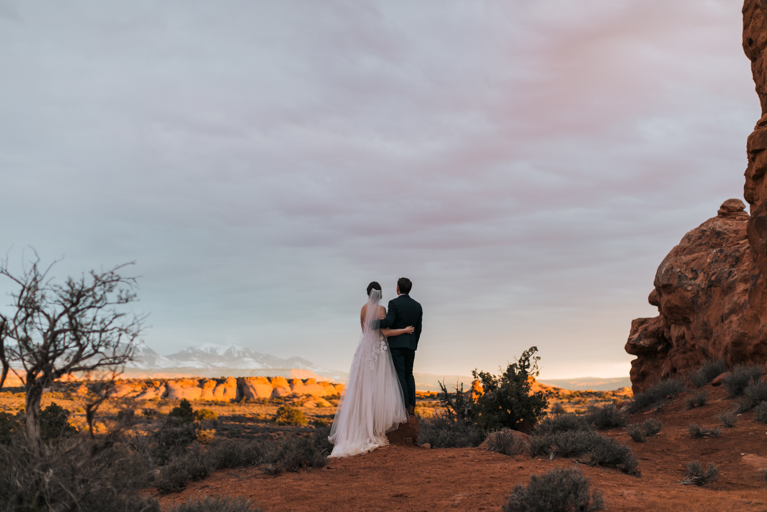 The Lasalle's in the background make sunsets in Arches National Park that much more beautiful.