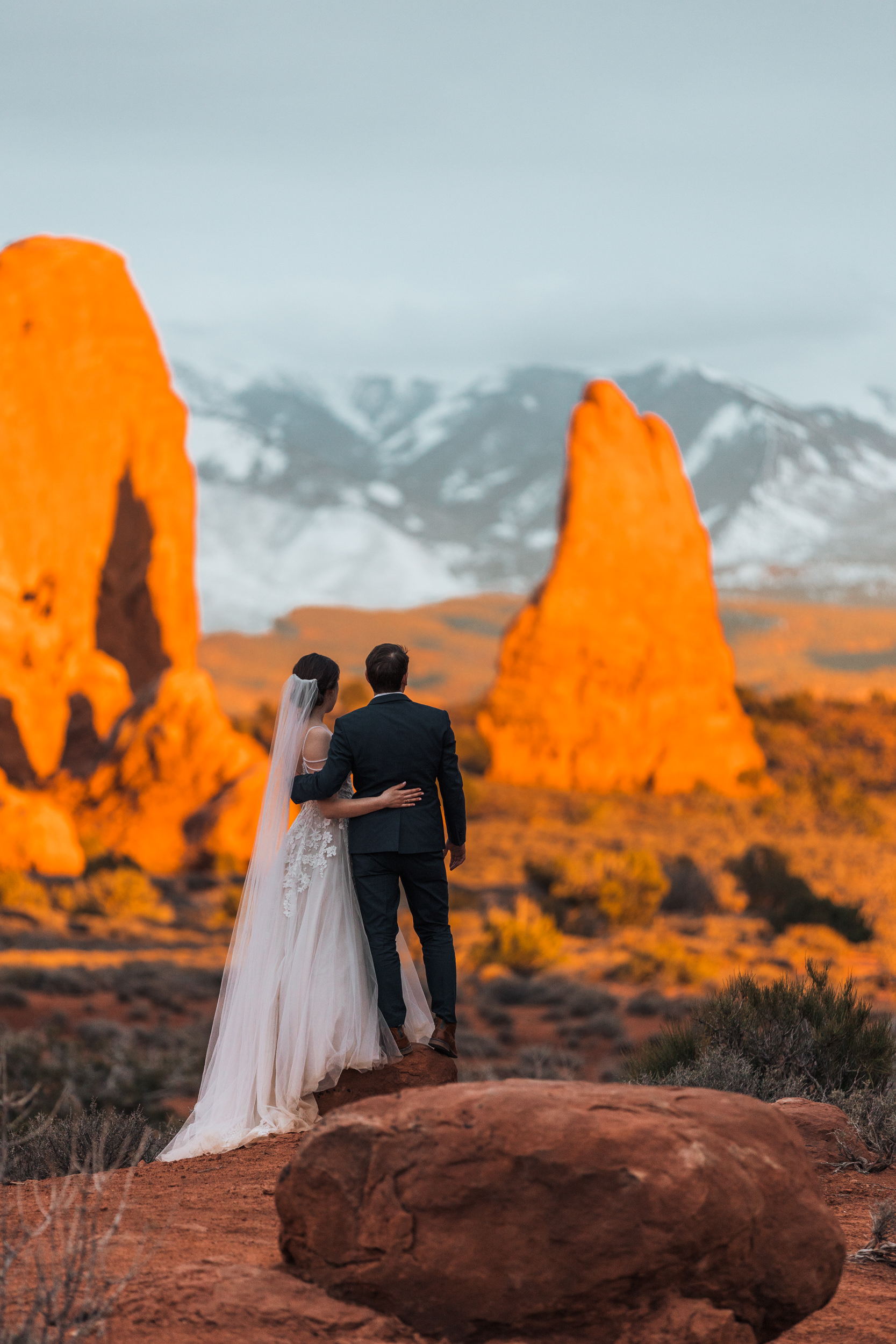 As the day winds down in Arches National Park, the light puts on a showcase with the red rocks. Quite a way to end your wedding day.