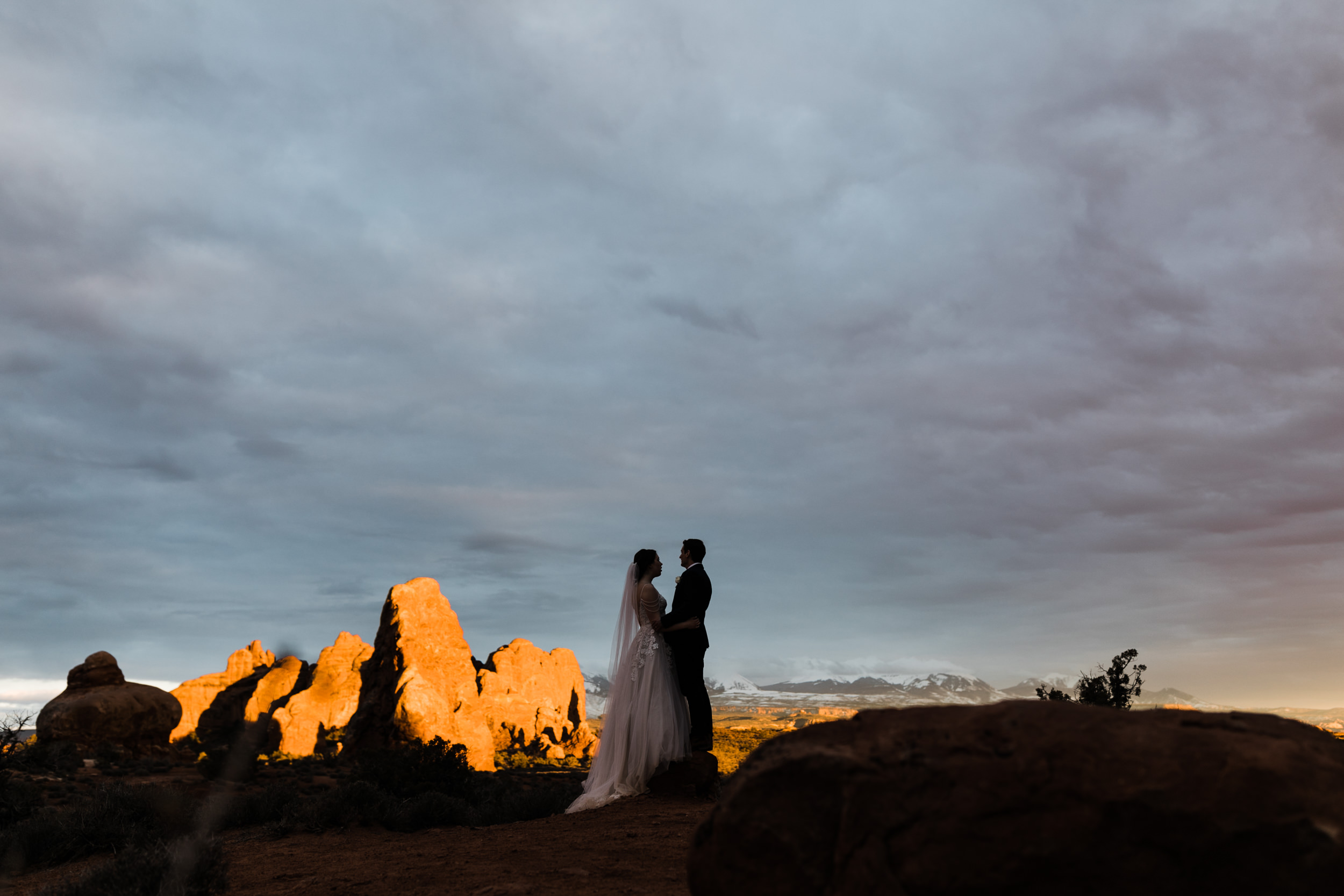 There's still amazing photos to be had after the sun has set in Arches National Park. The light stretches on to the last of the rocks lit up and beyond to the Lasalle Mountains.