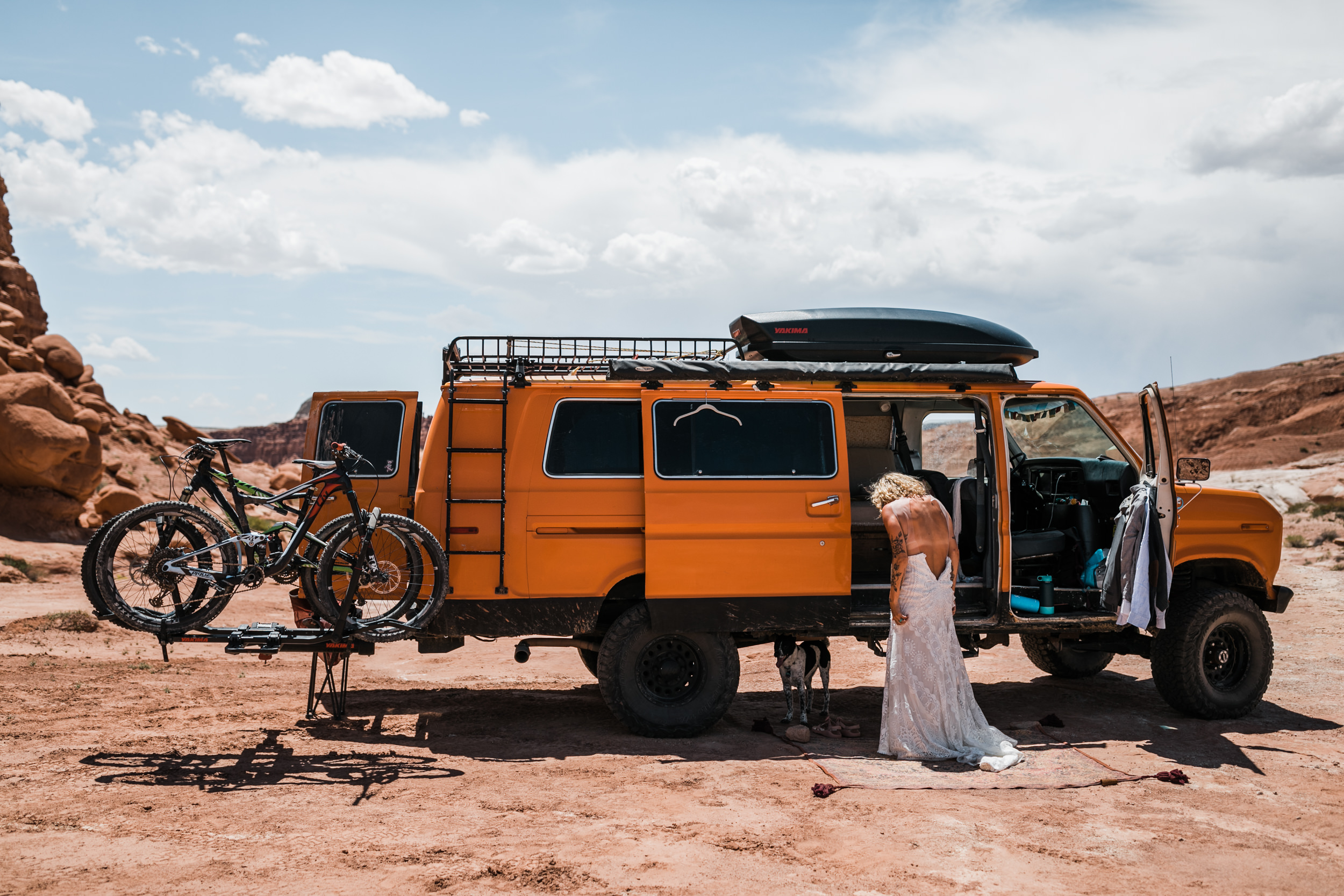 brianna madia getting ready for her elopement with her dogs bucket and dagwood in the utah desert